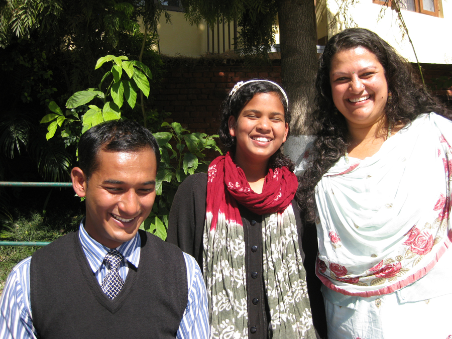 With Leena (our Director in Nepal, far right), Anjali receives her term grades from her teacher.