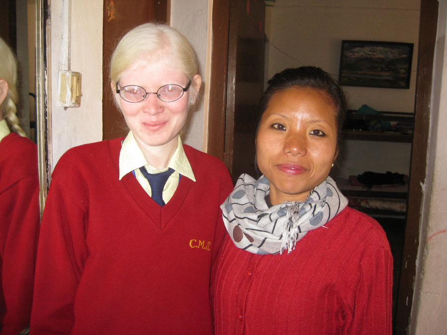 Puja meets to talk about her new school, which will offer more support for her low vision as a result of albinism.