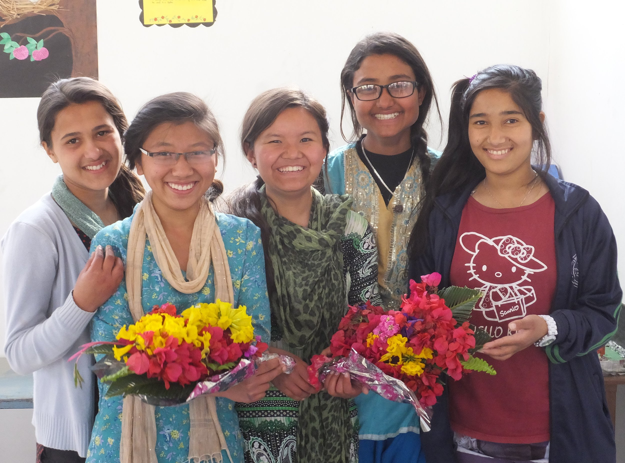 Some of our girls sharing their gift of flowers.