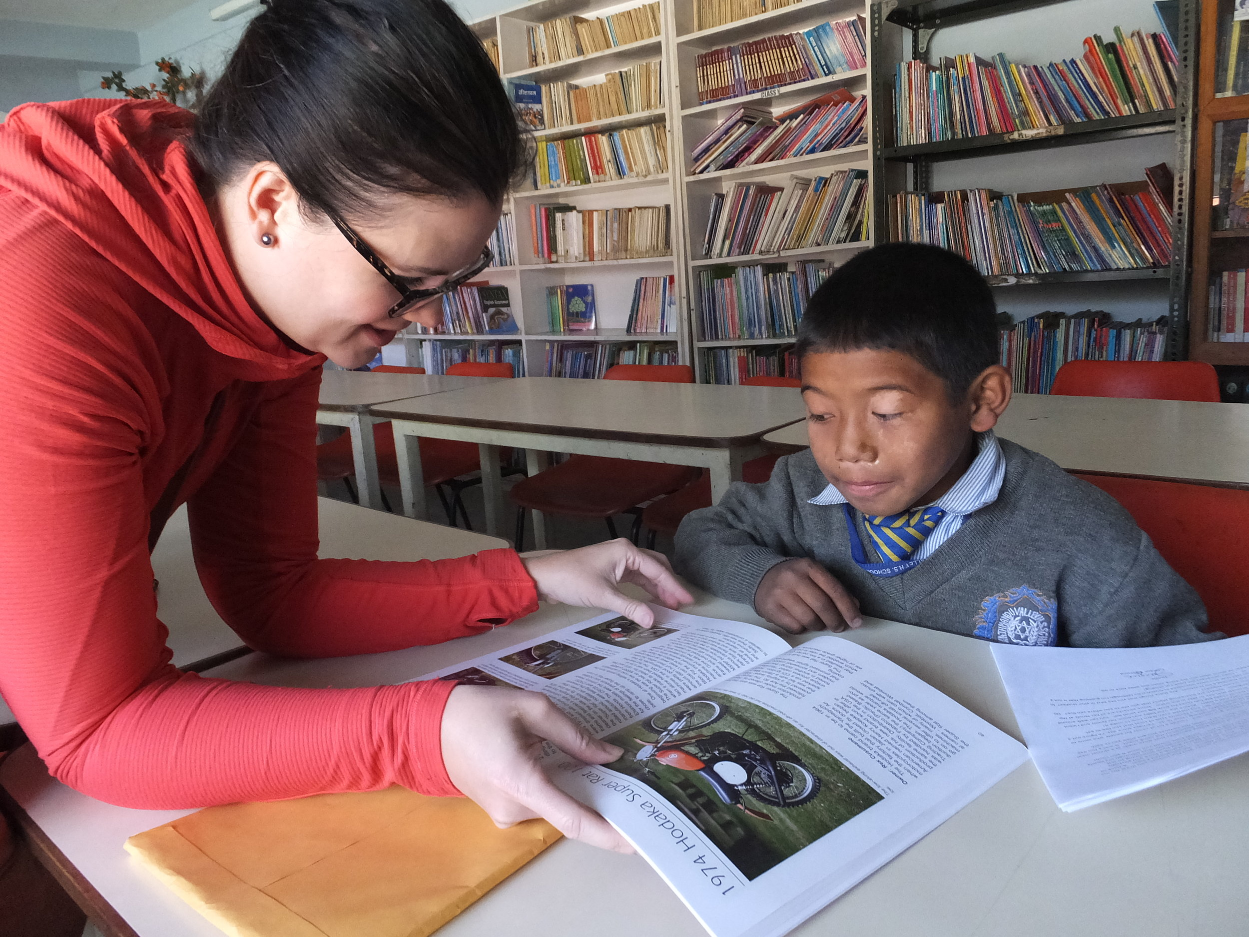 Alexis, Development Director, enjoys reading with one of the children.