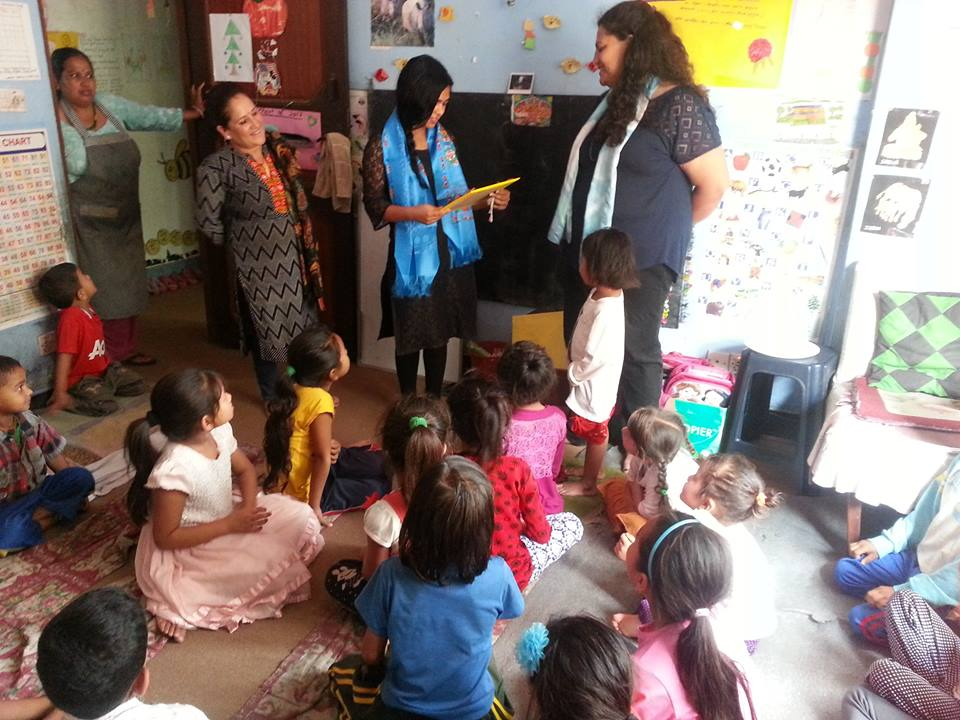 Rogina gets a special gift from the children for her exemplary teaching and service at the Contact Center