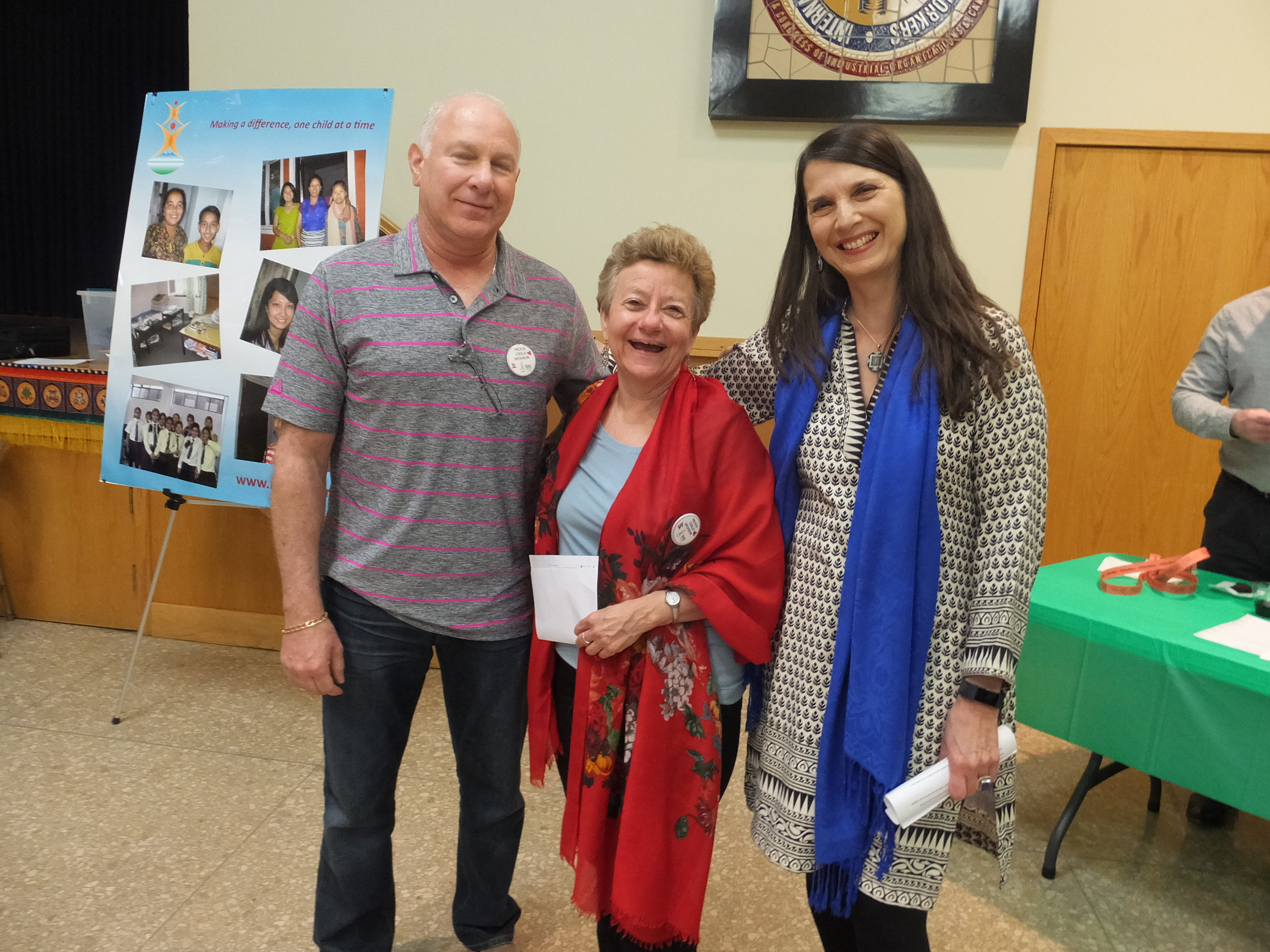 Board members Rick Hendin and Pam Hughes with Christine at Trivia Night in St. Louis, MO