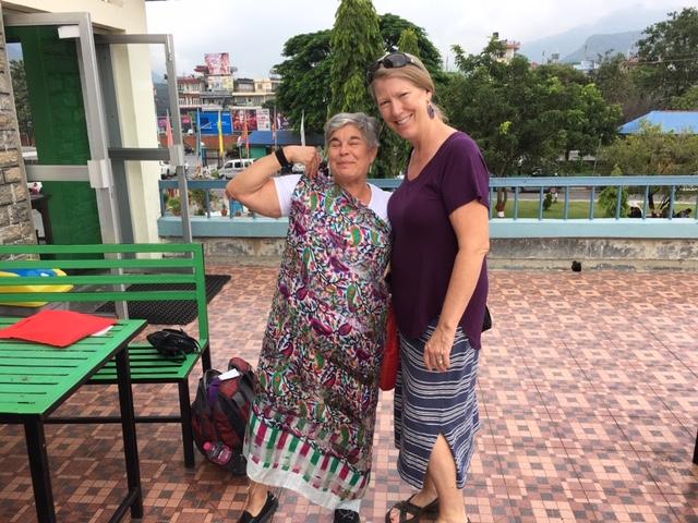 Child sponsor travelers Arlene Miller and Nan Pearson modeling their purchase in Pokhara, Nepal