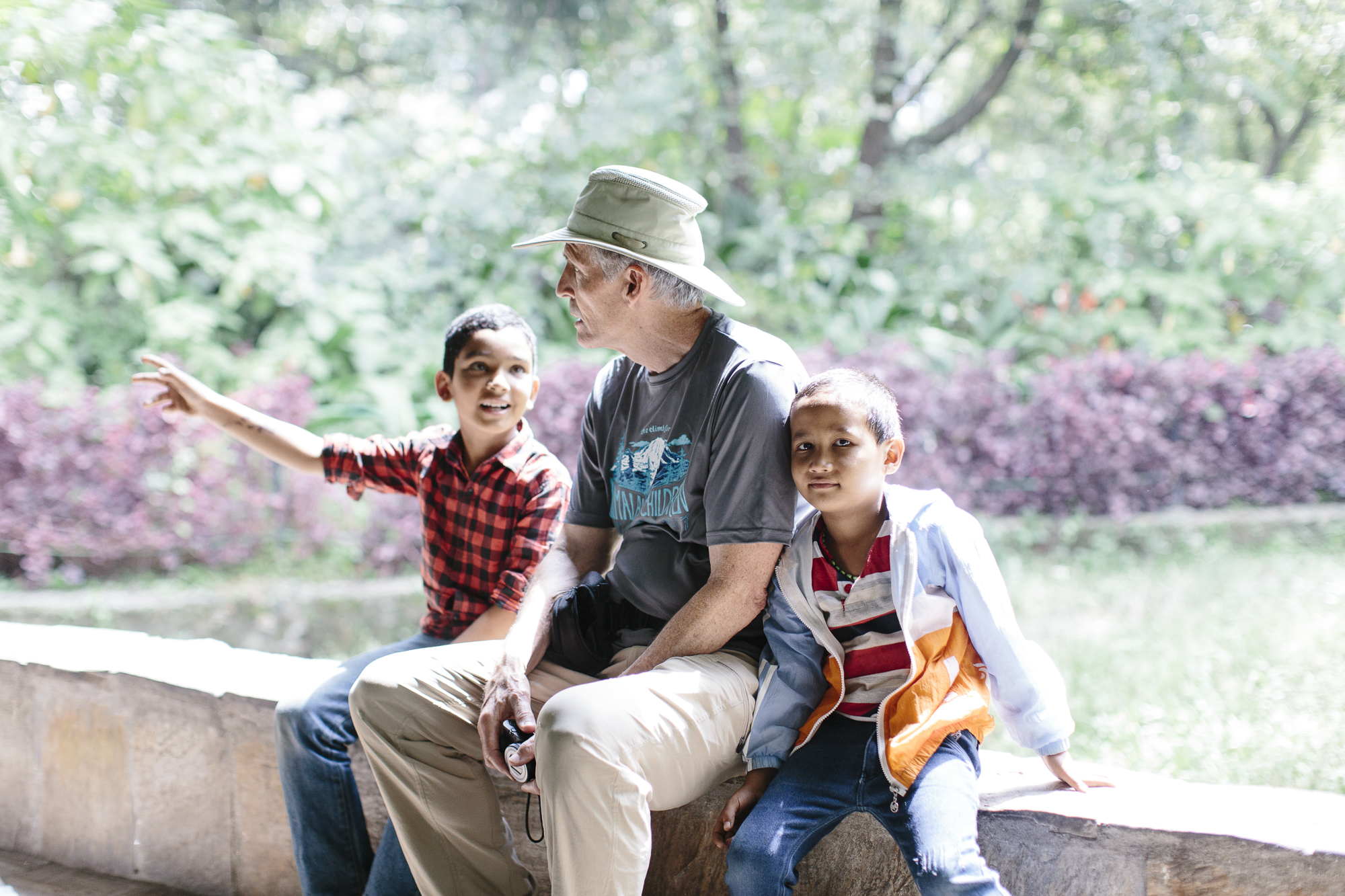 Rick and kids take a break and watch the animals at the Zoo