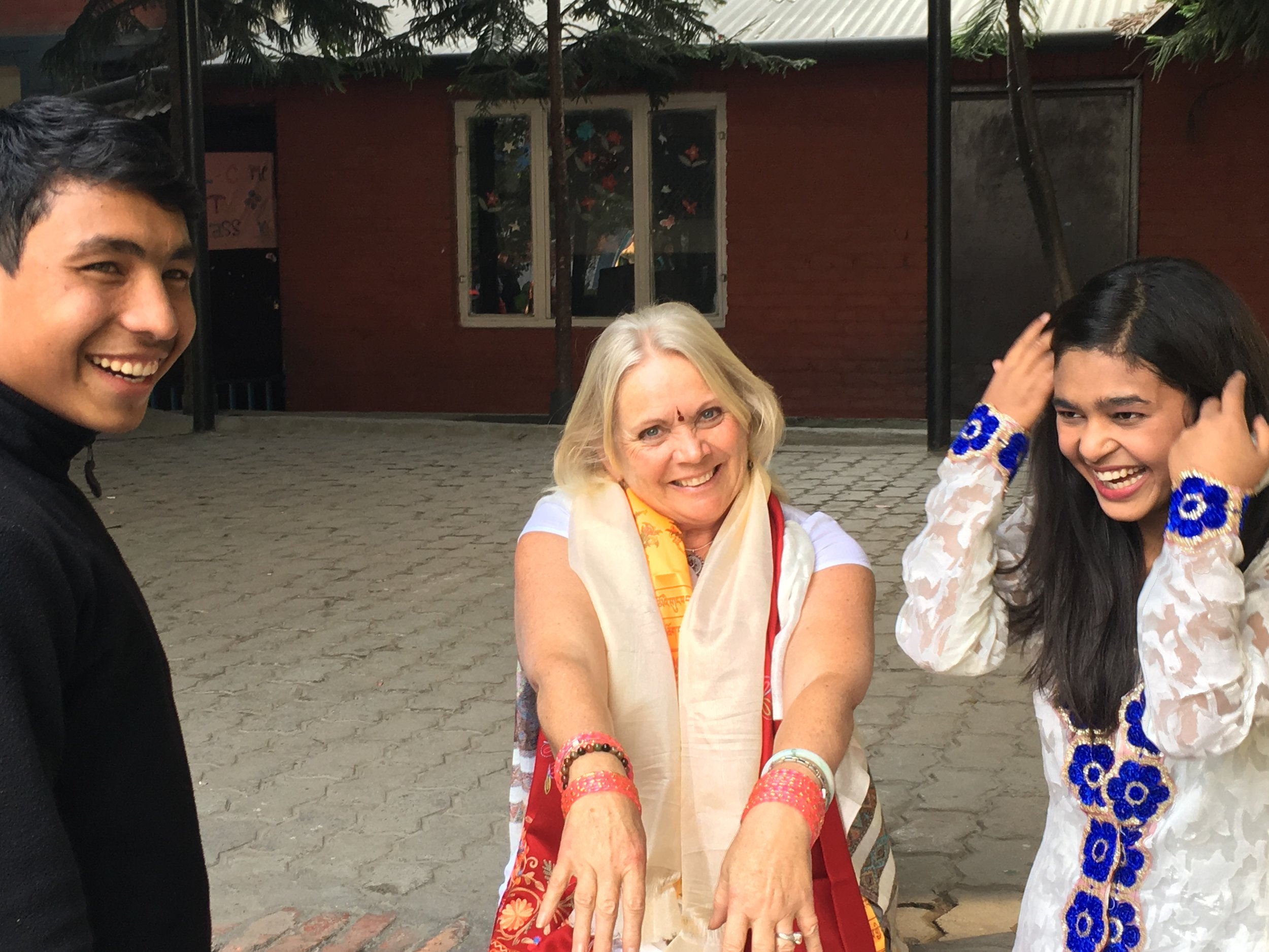 Reva Meadows (middle) experiencing Nepalese culture with her sponsored child, Bibek (left)