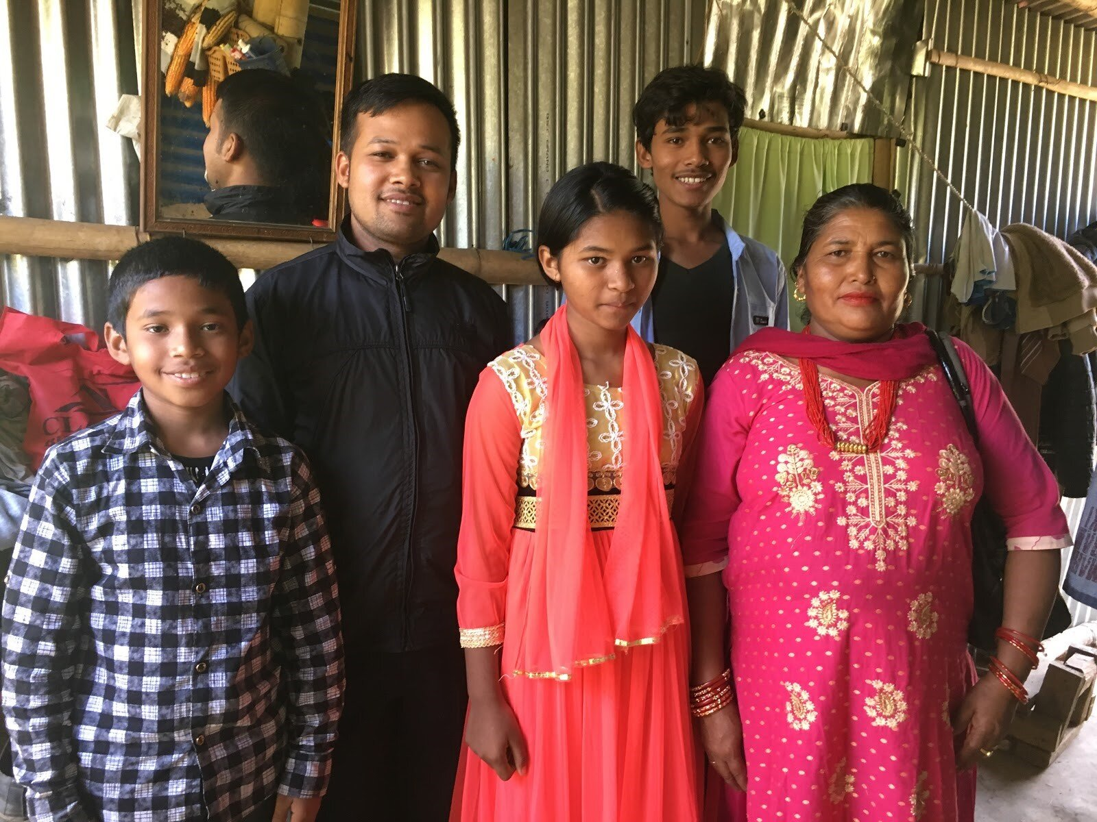 Kumar, Ram Kumar, Pawan, Purnima and their Grandma ready to go to the Mitrata graduation celebration.