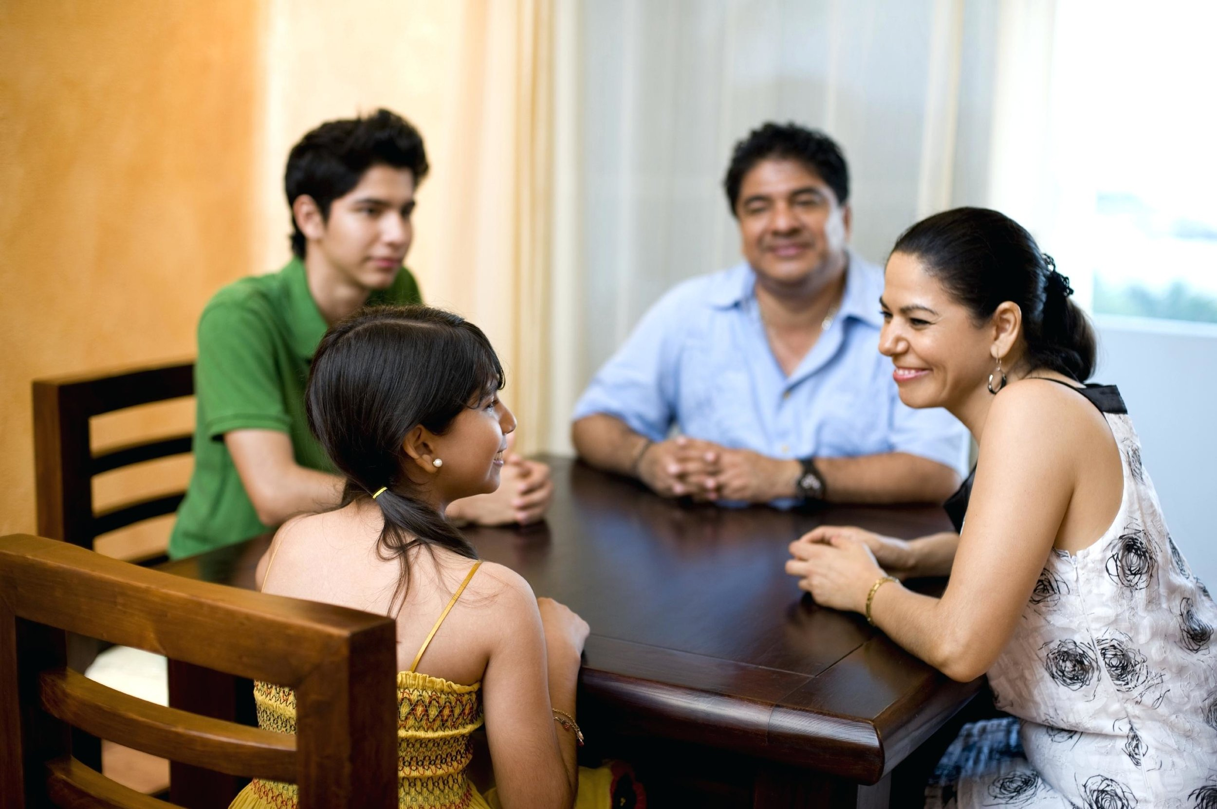 family-discussion-talking-at-table.jpg