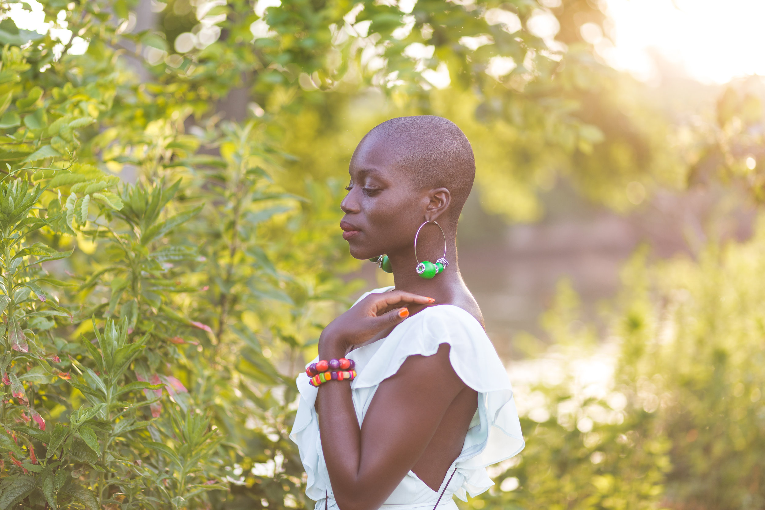"Abena Bempah walked into the beer garden where we met for drinks and the entire place turned and looked at her. Her confidence and smile draws people in and leave you wanting more. She is on a journey to 'discover beauty within and without' and has been inspiring others to travel and redefine beauty.  In the past few years, Abena has intentionally crafted her life around travel. She has been to beautiful intriguing places around the world such as Aruba, Turkey, UAE, Thailand, Holland, Croatia, Morocco, Italy and Columbia; the majority of her trips were solo.  On her recent trip to Turkey, her mother tried to persuade her not to go due to security concerns, offering to reimburse the cost of the ticket. Abena declined and had the trip of a lifetime.    ""If you think adventure is dangerous, try routine. Its lethal""  - Paulo Coelho  Abena is a budget traveler, determining her next destination based on the cost of the flight and will fly out of Newark/NY if needs be.   Her  Instagram  has the most beautiful iPhone selfies incorporating the essence of the locations. It is worth stalking and it is also a reminder that you don't need a big camera to take compelling photos.   Below are some of the gorgeous photos of Abena I captured when we met."