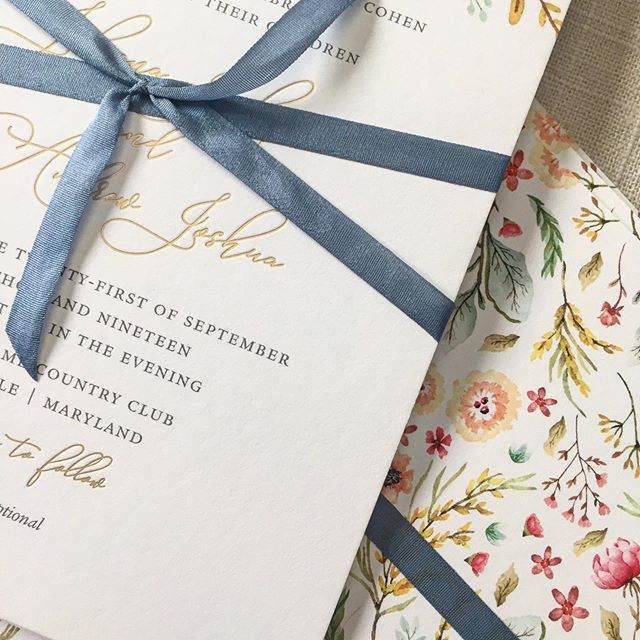 A little raw silk dusty blue ribbon and spot gold foil never hurts. Put the finishing touches on these floral stunners this week. . . #weddinginvites #wedding #invitations #custominvitations #floralinvitation #floral #rawsilk #ribboninvitation #dustybluewedding #dustyblue #mdwedding #mdweddings #baltimorewedding #graphicdesign #dailydoseofpaper #stationery #stationeryaddict #paperdetails #woodholmecountryclub #justinkonpaper #justinkonpaperinvitations