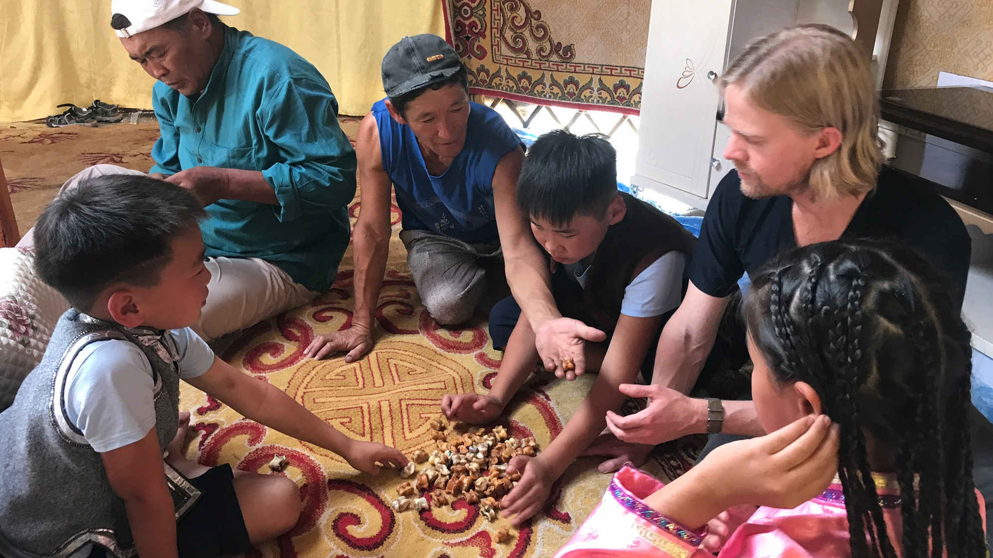 Learning a game played with sheep ankle bones in Mongolia.