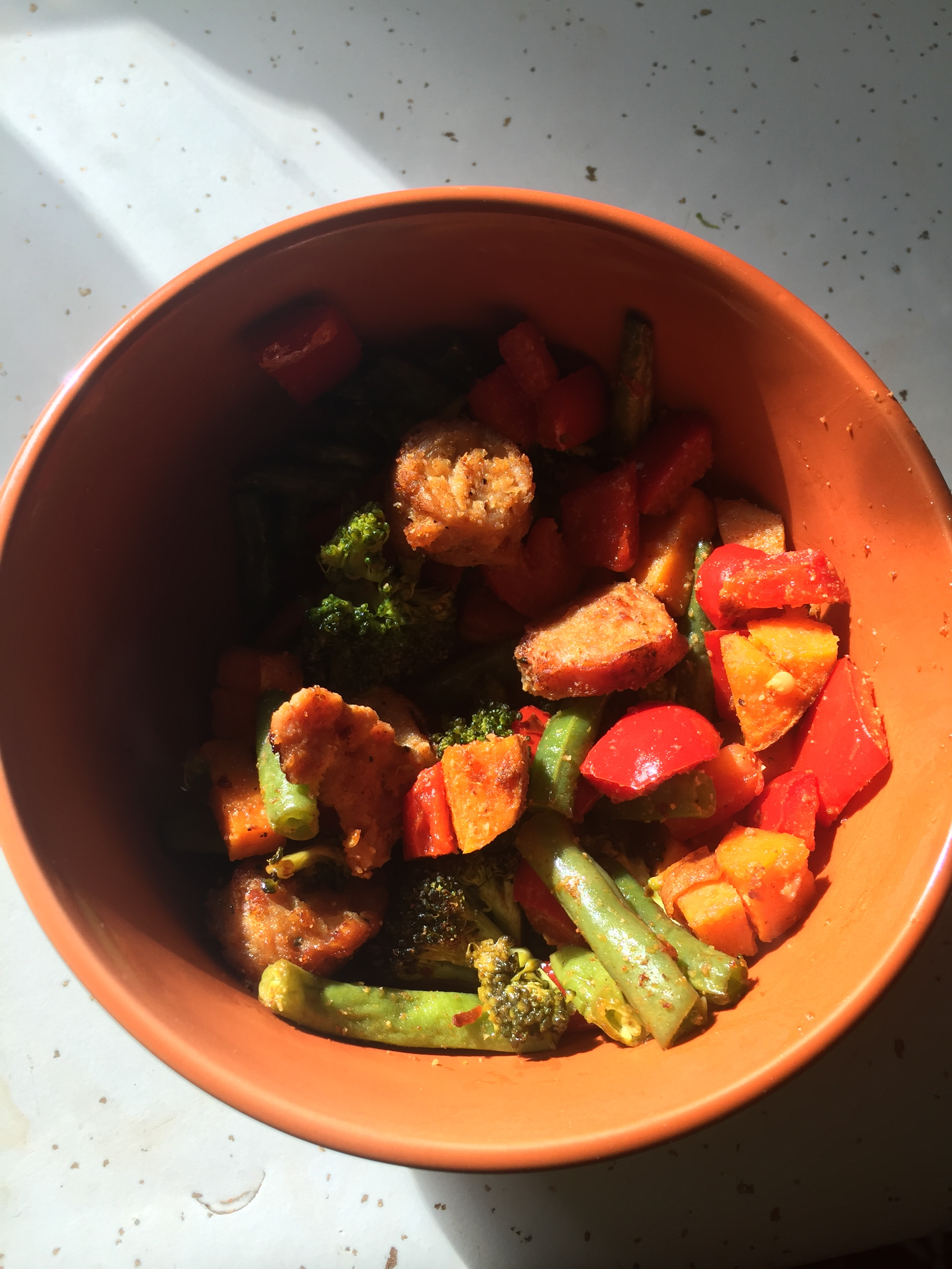 "Ingredients  lb of green beans ( trimmed and cut)  broccoli (medium crown)  red pepper (medium dice)  2 sweet potatoes (cut into bite size pieces)  9-13 oz of chicken or turkey sausage (either smoked ahead of time or browned/cooked in a skillet)  cumin (to taste)  paprika (to taste)  salt and pepper  powdered garlic  red pepper flakes  6 tbls of olive oil                                                            Plan of Attack  Preheat the oven to 400 degrees  Coin the sausage (I had 5 links, but you could have 6 or more)  Chop and trim the vegetables  Add vegetables and sausage to medium mixing bowl. Toss vegetables and sausage coins with olive oil and spices.  Line sheet pan with parchment paper and add vegetable/sausage combination  Put in oven for 15 minutes; remove and stir mixture;  Put back in the oven for a total of 30 minutes.  *Serve and enjoy!!!  * The recipe initially didn't have cumin (but I added with a liberal hand). I like spicy hot and spice...so this was a big hit in my lonely kitchen. You could serve over quinoa but I would just add more sausage. It is a battle cry in my house ""more sausage!"". Just kidding of course...we're way choosy about our sausage and our vegetables! Your body is your temple and I am choosy about feeding mine only my best sausage!"