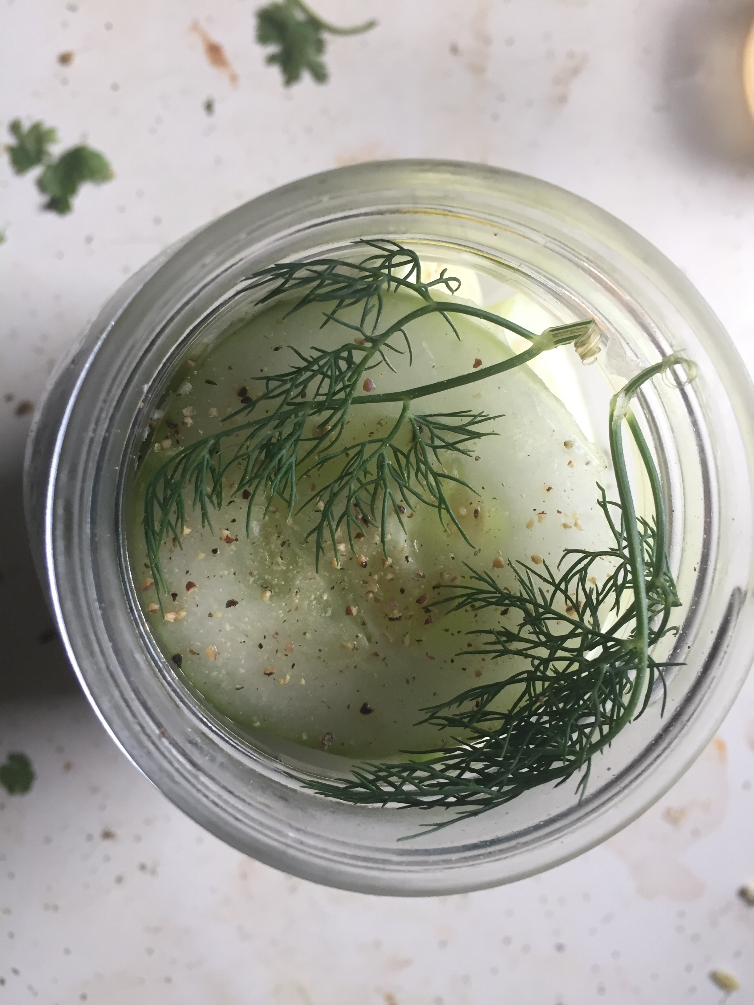 Crush black pepper into the cooled brine. Pour the cool brine into the mason jars so the brine goes up to the top of the jar. Put the lids on and refrigerate in the fridge for 3 days.  Optional: Spicy garlic dill pickles (see below)