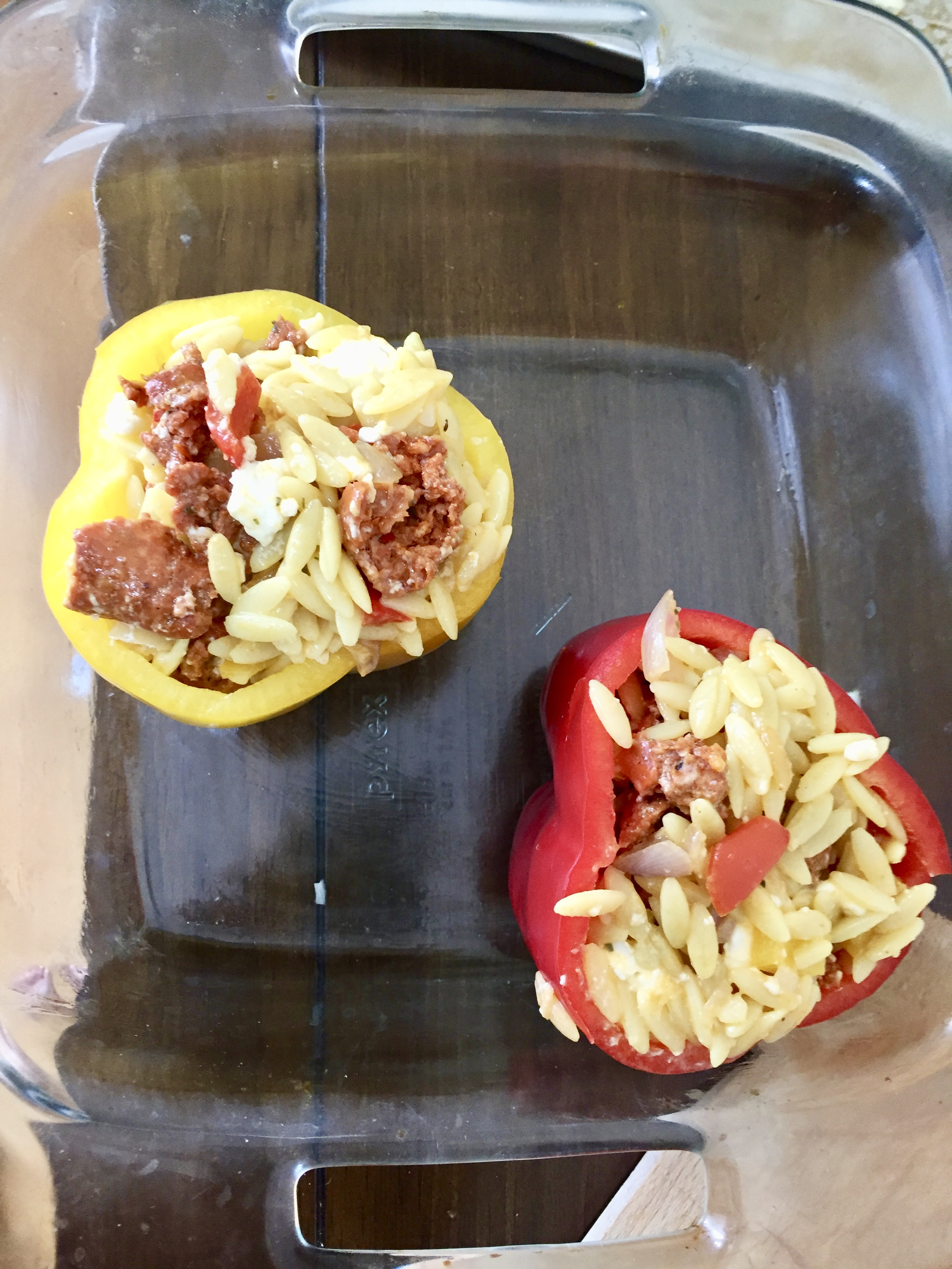 Stuff the peppers with the orzo mixture and place on an olive oiled baking dish. Put in the oven for 25 - 40 minutes (depending on your oven). Mine were in for 30 minutes and it worked perfectly.