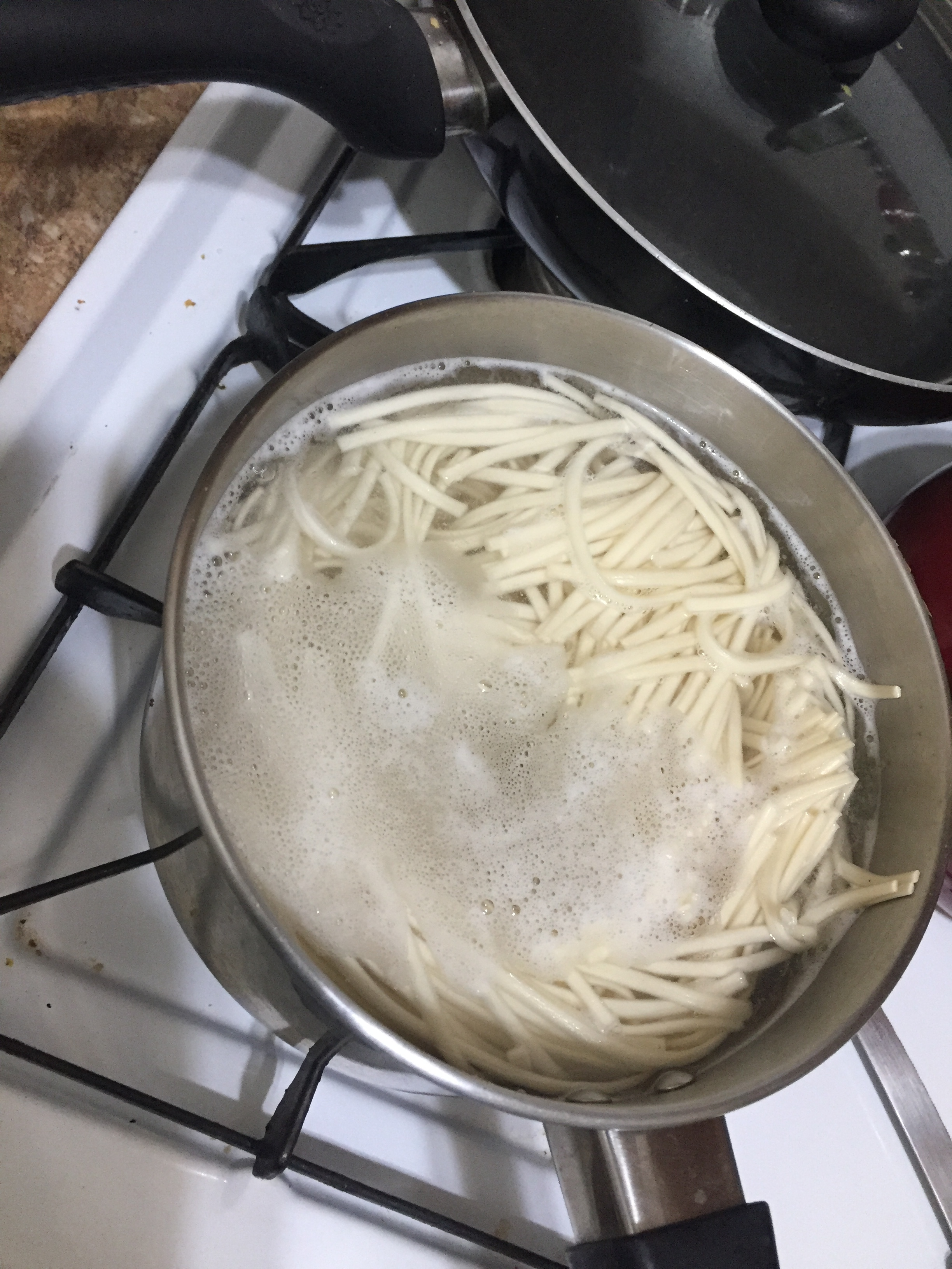Bring 3 qt of water to boil and add the package of Kame noodles. When they rise to the top, cook for 9-11 more minutes and then drain. Rinse in cold water until noodles are room temperature-cool. Set aside