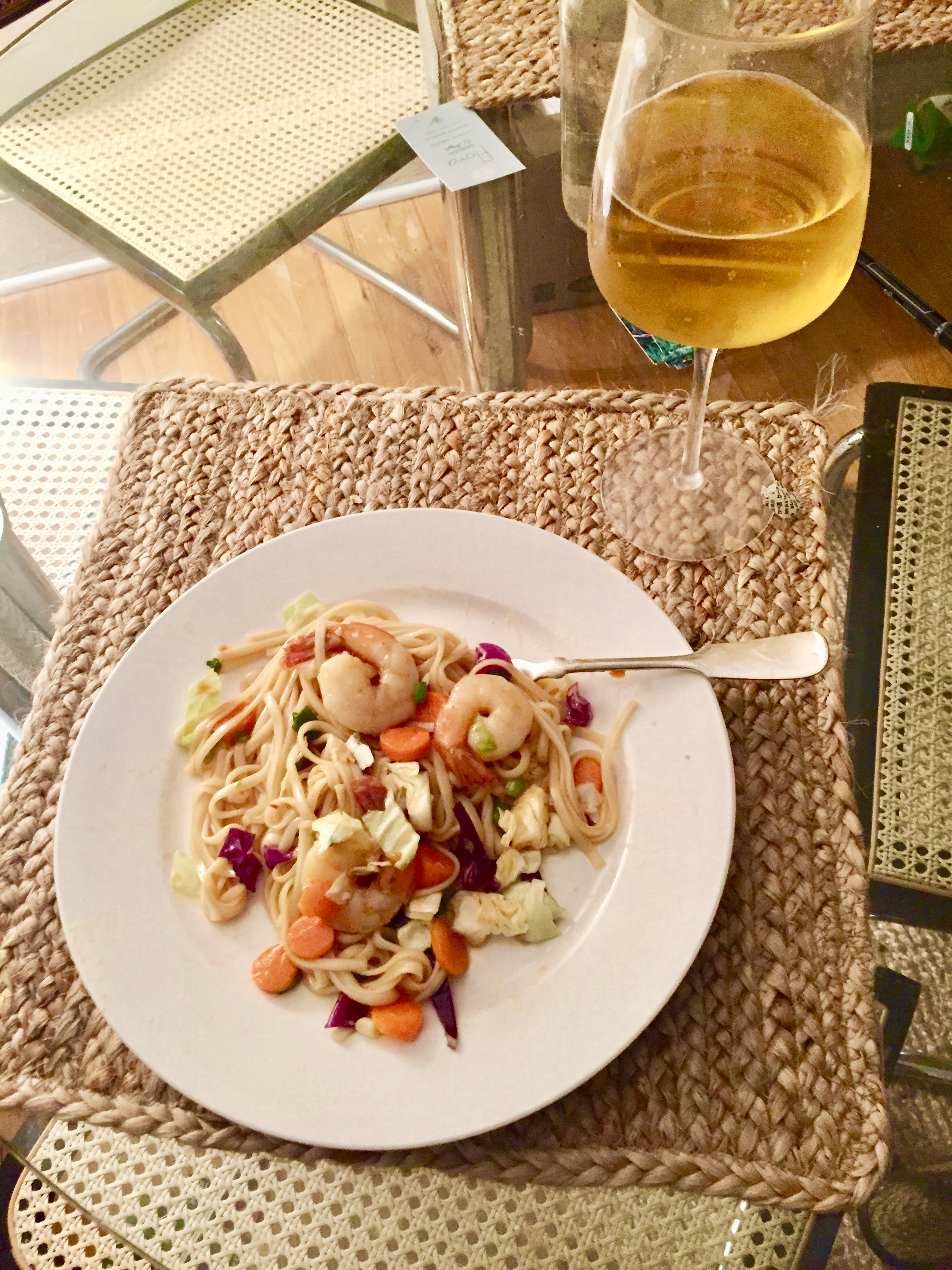 My comments: At the very top of the list let's be clear. This might be wine in the glass, but if I am very classy it is Coors light. Just sayin...  This recipe is delicious, and surprise of surprises- it tastes better the next day. I am not a fan of wilting...well anything, and the vegetables hold up after some time in the fridge. I would recommend adding the Cilantro individually to keep the flavors clean. I ended up adding more soy sauce after the whole salad was assembled but if your blood pressure is not chronically low (As mine is) then ya probably don't crave sodium as I do, which,well, is as much as a fat kid loves cake. I would say I could see adding radishes to the mix, for an additional crunch and possibly adding more ginger to the sauce. I would say also, I would try with a little bit of Thai Basil, as some kind of fusion variation. I got this recipe from the back fo the Kame noodle package and then adjusted a little bit for my palate and for my eating enjoyment. Instead of stir fry oil, I used olive oil and I think it made very little difference. I would say you could grate the carrots instead of cutting them into slender coins, but I have nothing in my Air BnB with the capability to grate, so I coined em...I think the most important thing about this recipe is to make sure the noodles are very cold before they're added to the vegetable mixture. The recipe also said to use Cole Slaw mix but I went to my local Farmer's market and bought fresh cabbage in lieu of the prepackaged chemical laden mix.