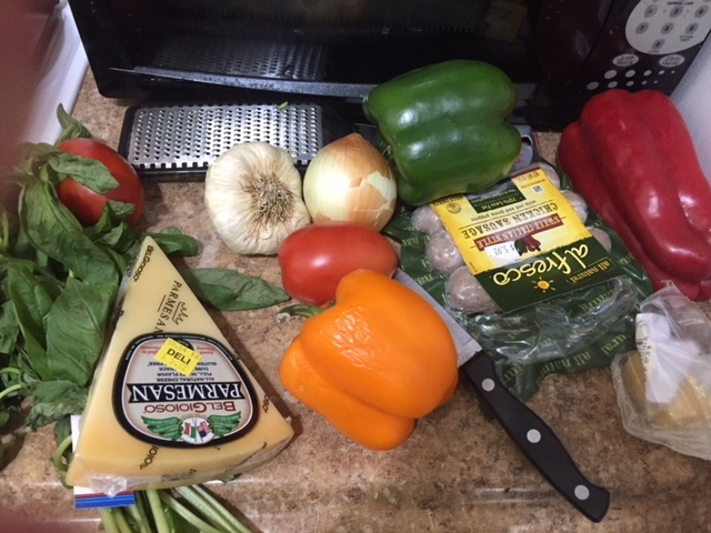 Ingredients  Parmesan Cheese  Orange, Red and Green Bell Pepper  Bunch of Basil  5-6 Cloves of Garlic  Spanish Onion  3-6 Chicken Sausage Links *with red and green peppers  2-3 tbls of brown sugar  Sea Salt  Olive Oil  Plum tomatoes (2-3 medium)                                     Plan of Attack