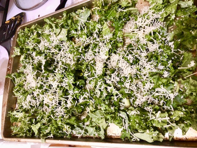 (In photograph: kale chips covered in parmesan before being put in the lovin')