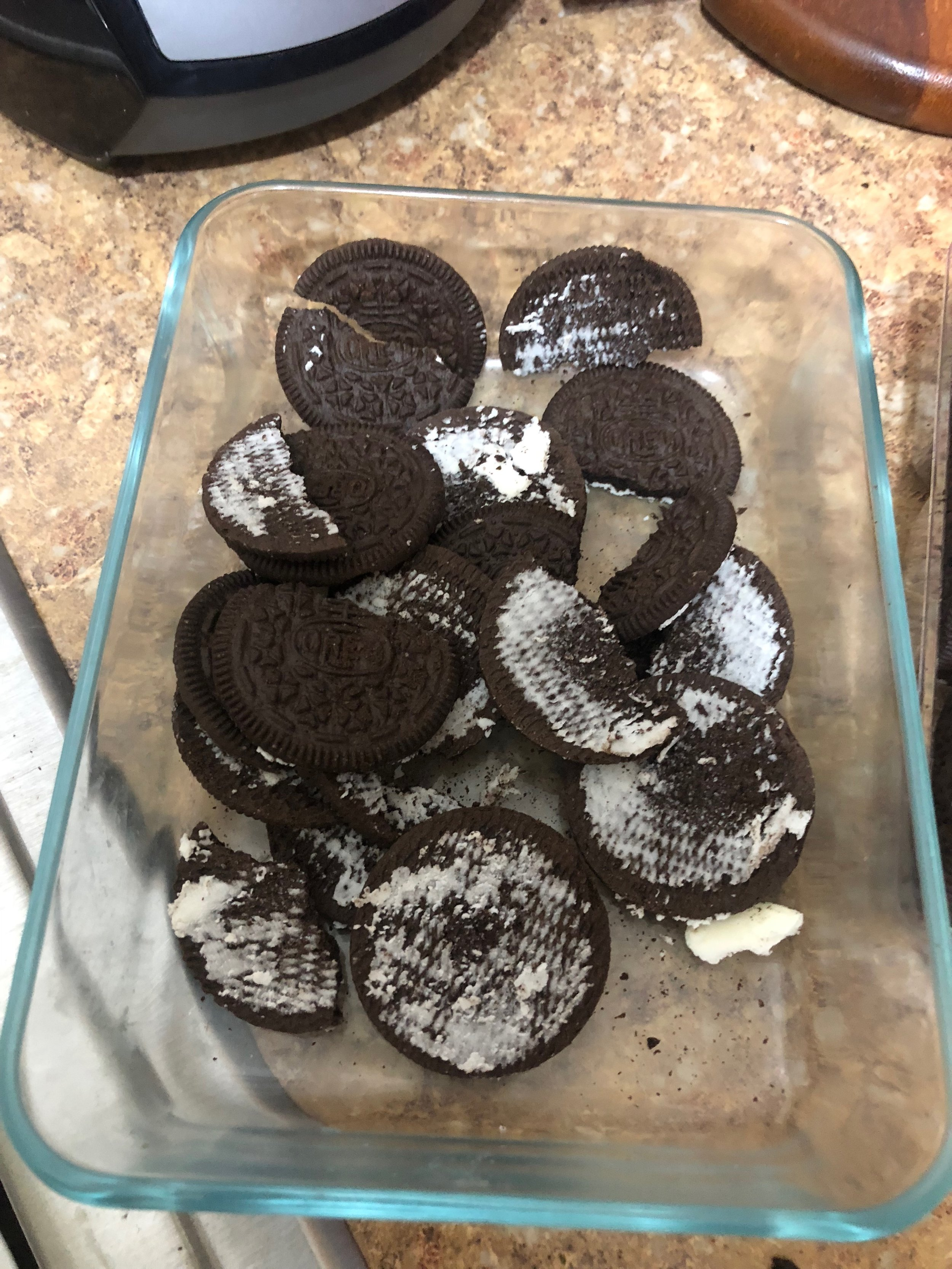 Take 22-25 Sandwich cookies and with your butter knife, scrape the frosting inside into another container. (if ya add 26, nobody is gonna complain!)  Put the cookies into a ziplock baggie. Using your hands (or a rolling pin) crush the Oreos into a mixture of crumbs and bite size pieces.