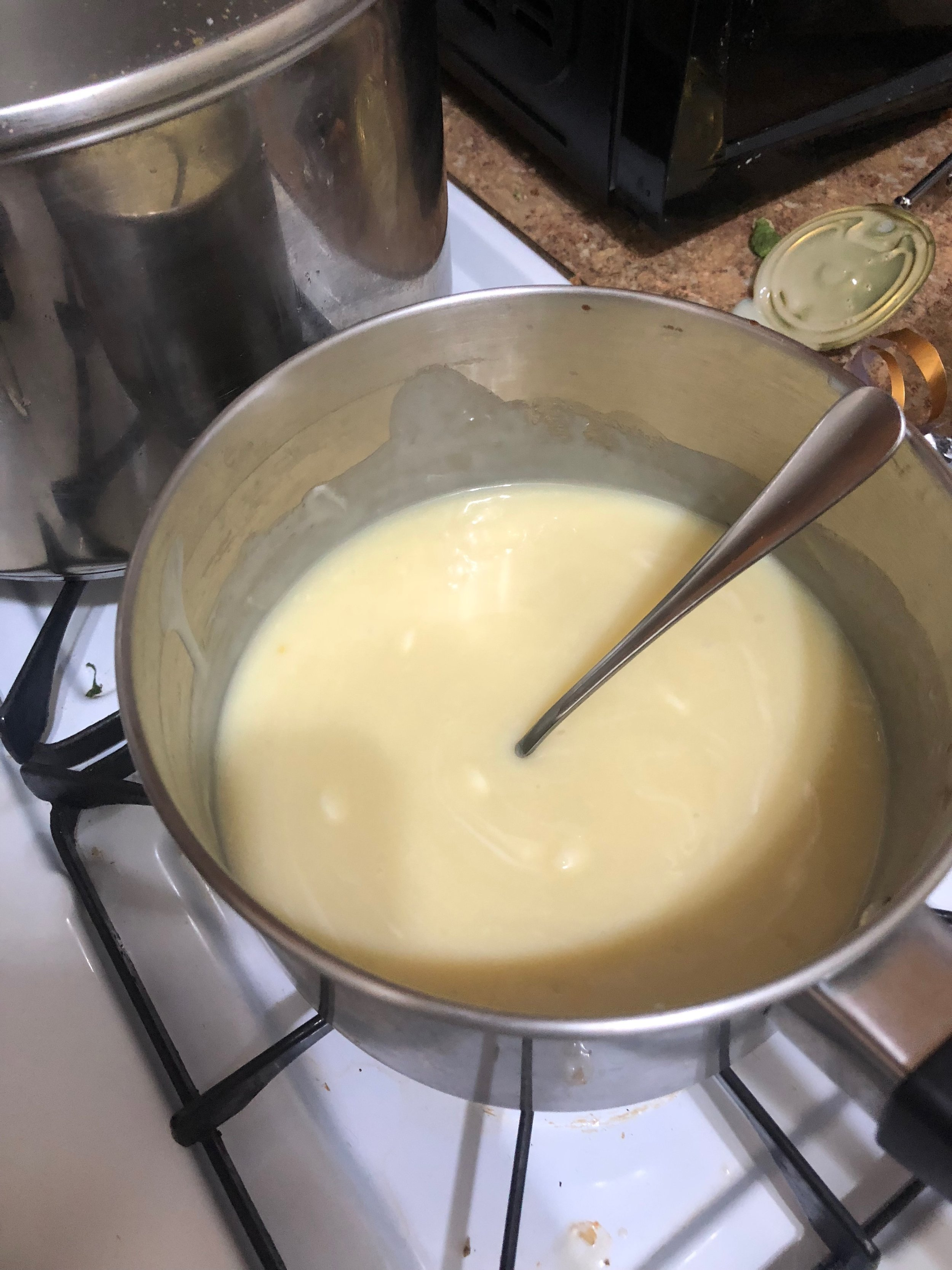 Add the an of condensed milk, 2-3 cups of white chocolate chips, 2-tbls of butter and a sprinkling of salt to medium saucepan over low heat. Add the chips in batches, making sure to continuously stir the mixture so the bottom of the pan does not burn and the chips, butter and milk are all integrated. When everything is mixed, you have the option of adding the vanilla.