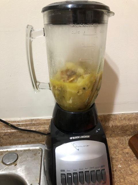 With a wood spoon, move 0.5 of the mixture to a blender and puree.