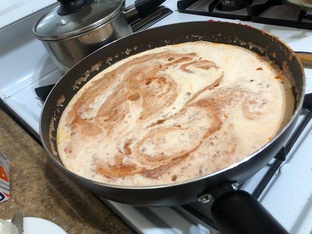 Add cream to sauce (testing to make sure the sauce is not so hot it'll curdle)