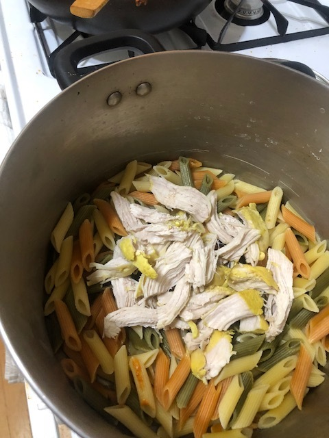 While the sauce is cooking, cook a medium box of penne (tricolor pictured) and poach 2 chicken breasts in chicken stock in a sm covered saucepan. Shred the cooked chicken and put on top of drained/cooked pasta.Pour some of the sauce generously into the pot with the penne and chicken. Mix thoroughly.