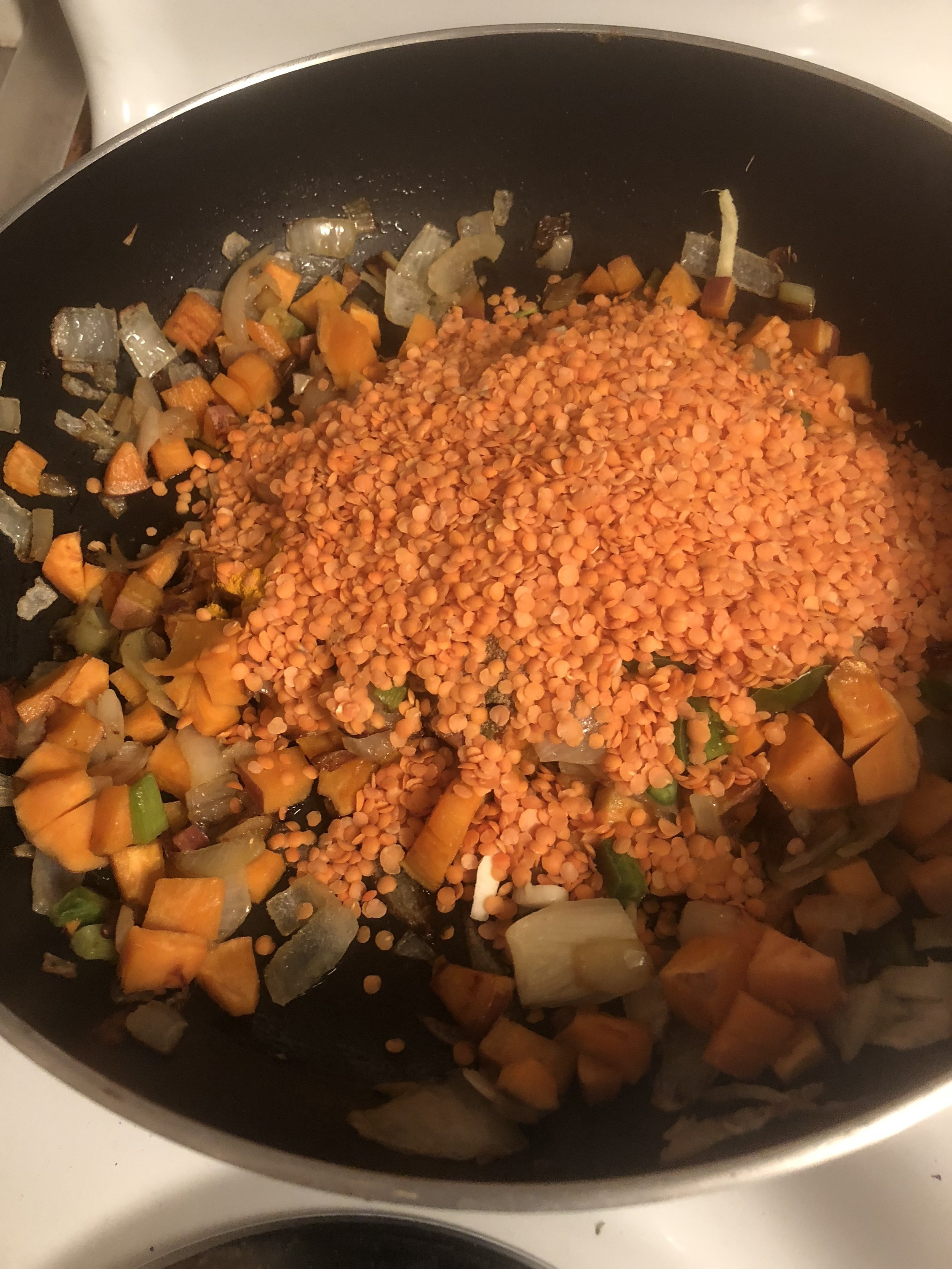 Add the lentils on top, stirring so all the lentils are coated with oil
