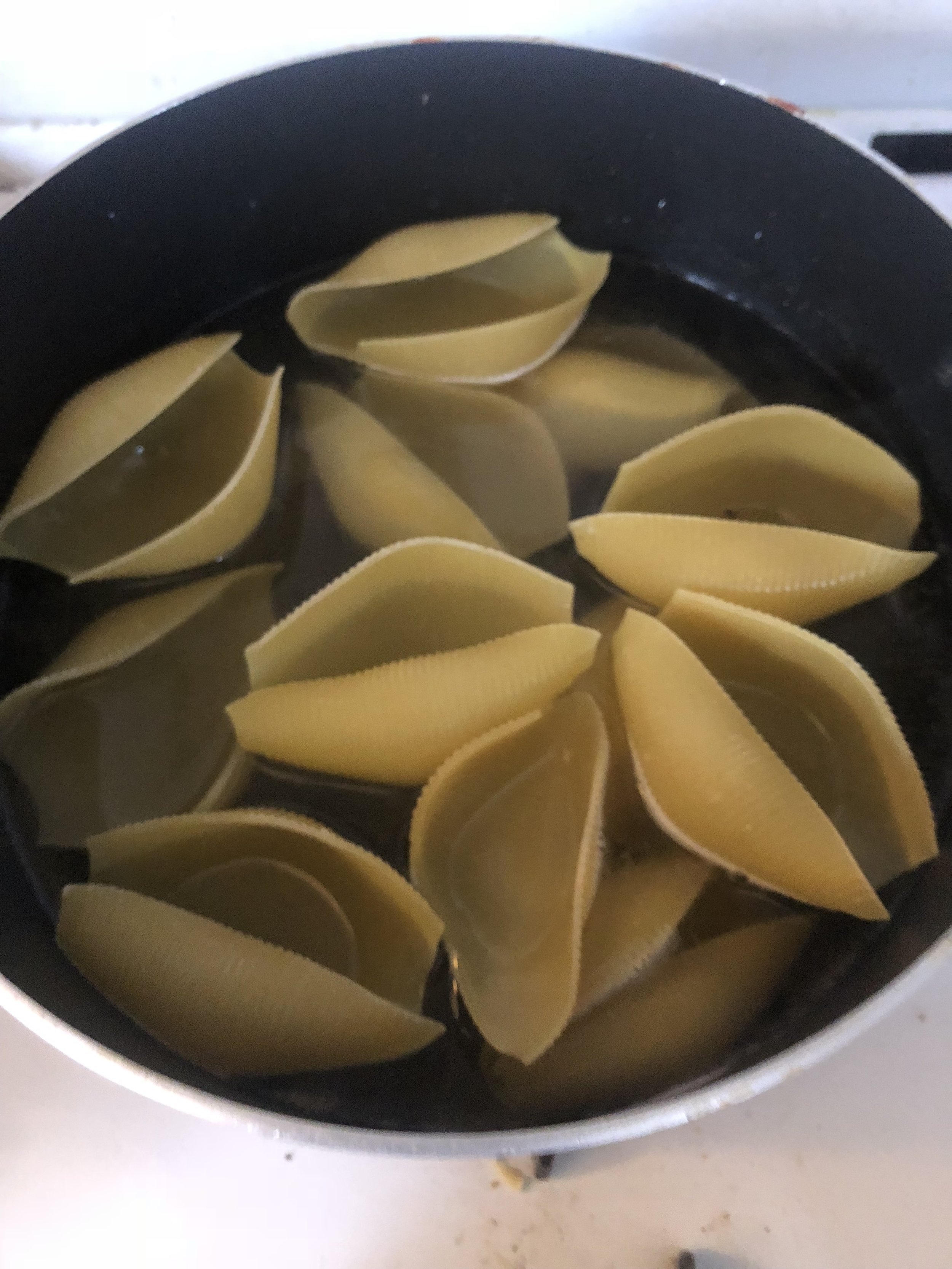 Boil 6-9 cups of water and then add the shells to the boiling water.