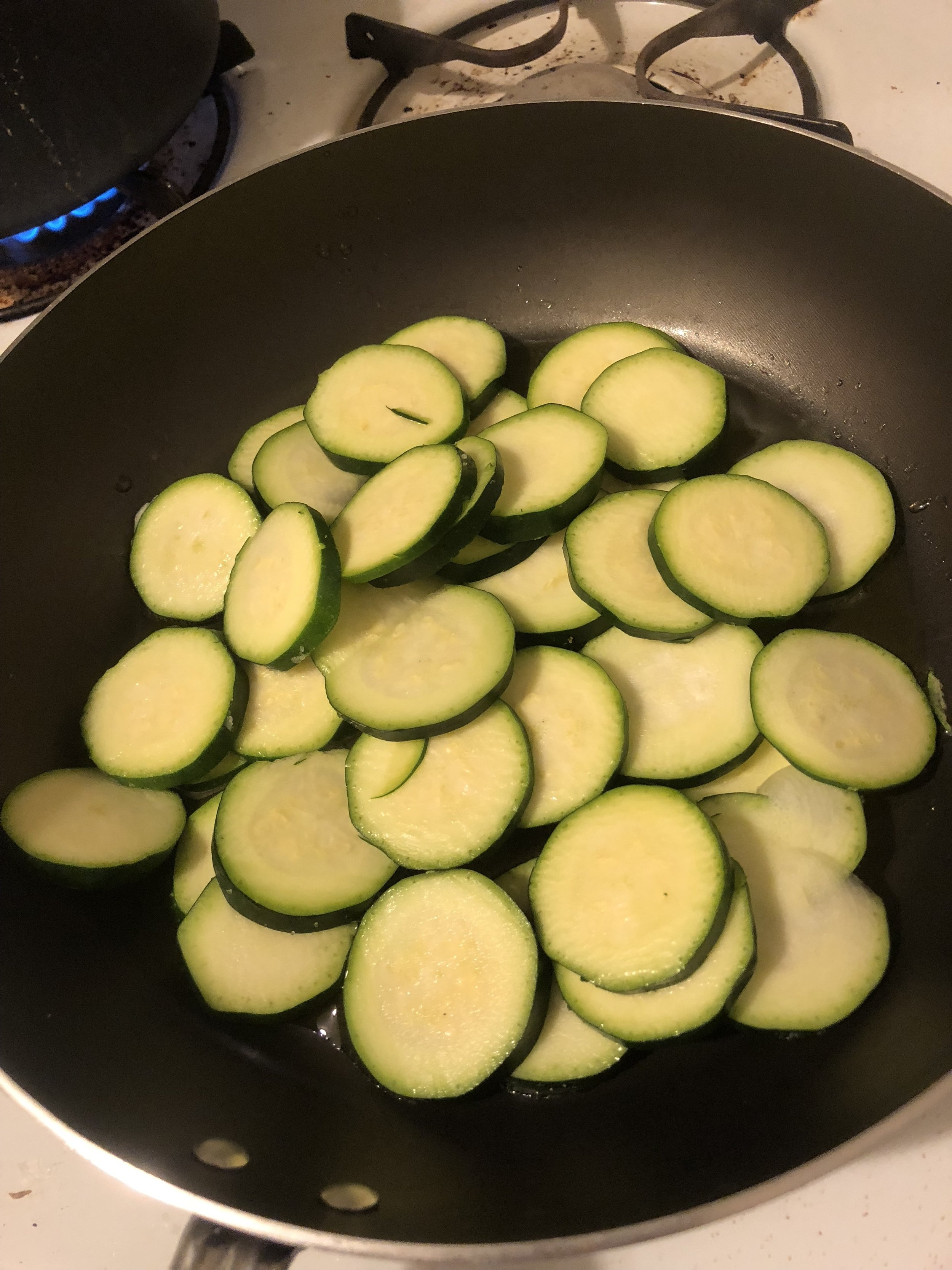 Heat Oil in your medium pan and cook until cooked through. While zucchini cooks, clean and dice the red bell peppers into bite sized pieces.