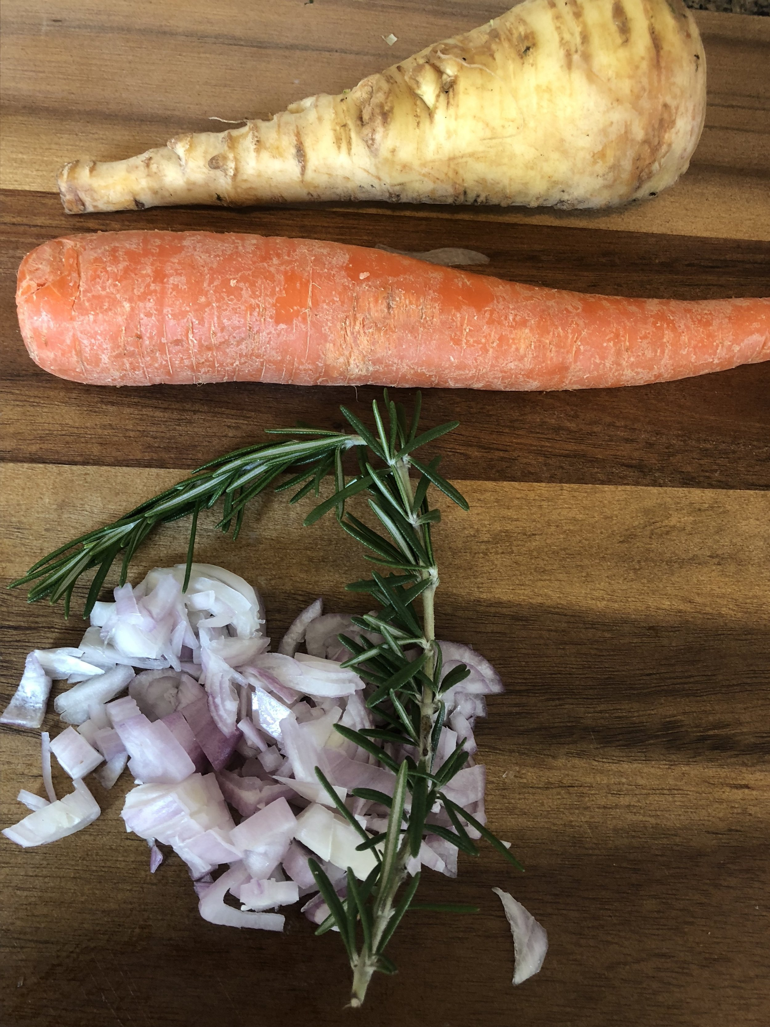 Dice your onions and shallots. Add 2 tsp of butter or olive oil to the bottom of your stockpot and then add onions and garlic, cooking until clear and aromatic. Then add the reserved chicken stock, coined carrots, cleaned and coined parsnips, another sprig of rosemary and chicken. Turn on medium heat and cook to complete integration. Cook the orzo in a medium saucepan according to directions on the box, until just under al dente. Add the nearly cooked orzo to the cooking soup and leave on heat for 5-13 minutes more to allow for it to cook thoroughly in the soup broth. Remove the sprig from the soup and serve got and smiling...Flavanoids, what what...