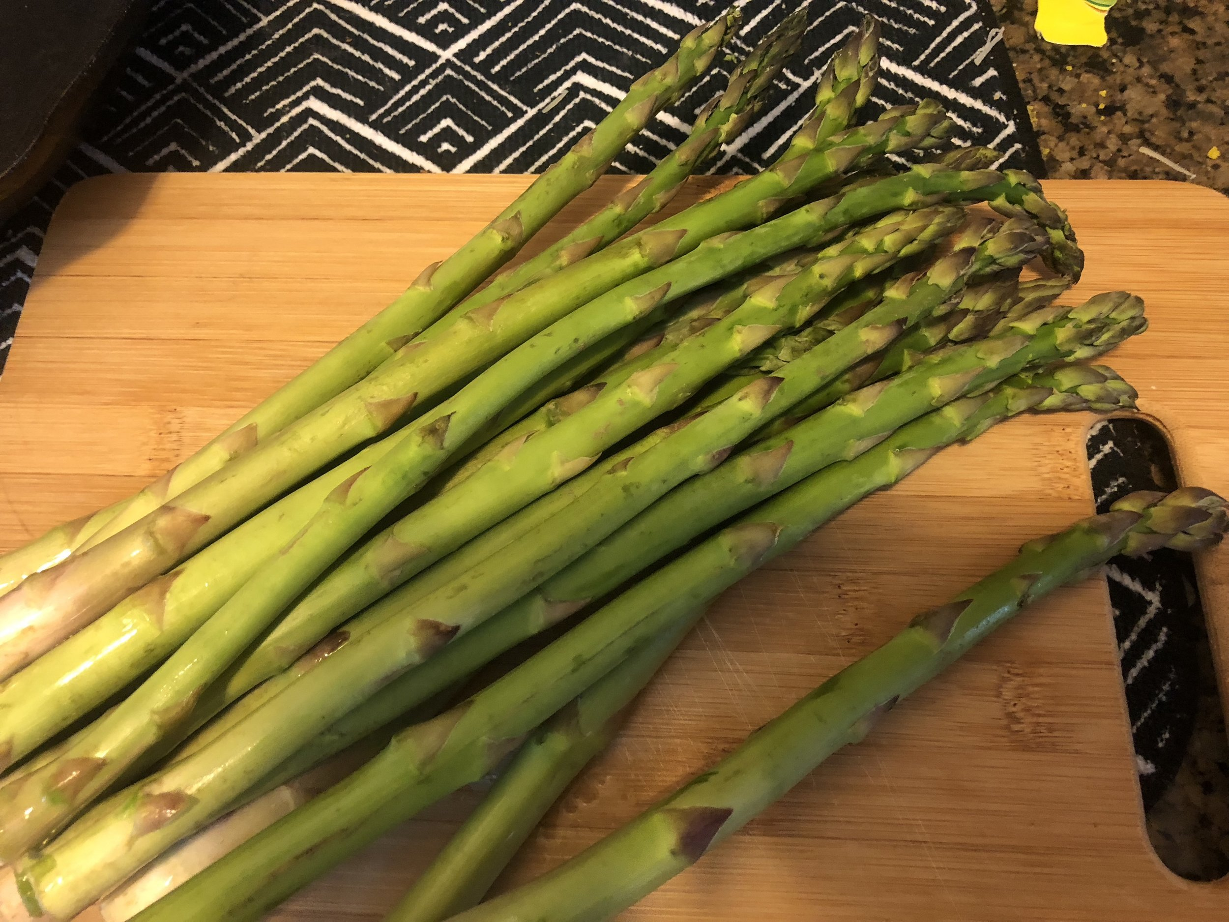 Clean your asparagus into bite sized pieces, removing the ends.