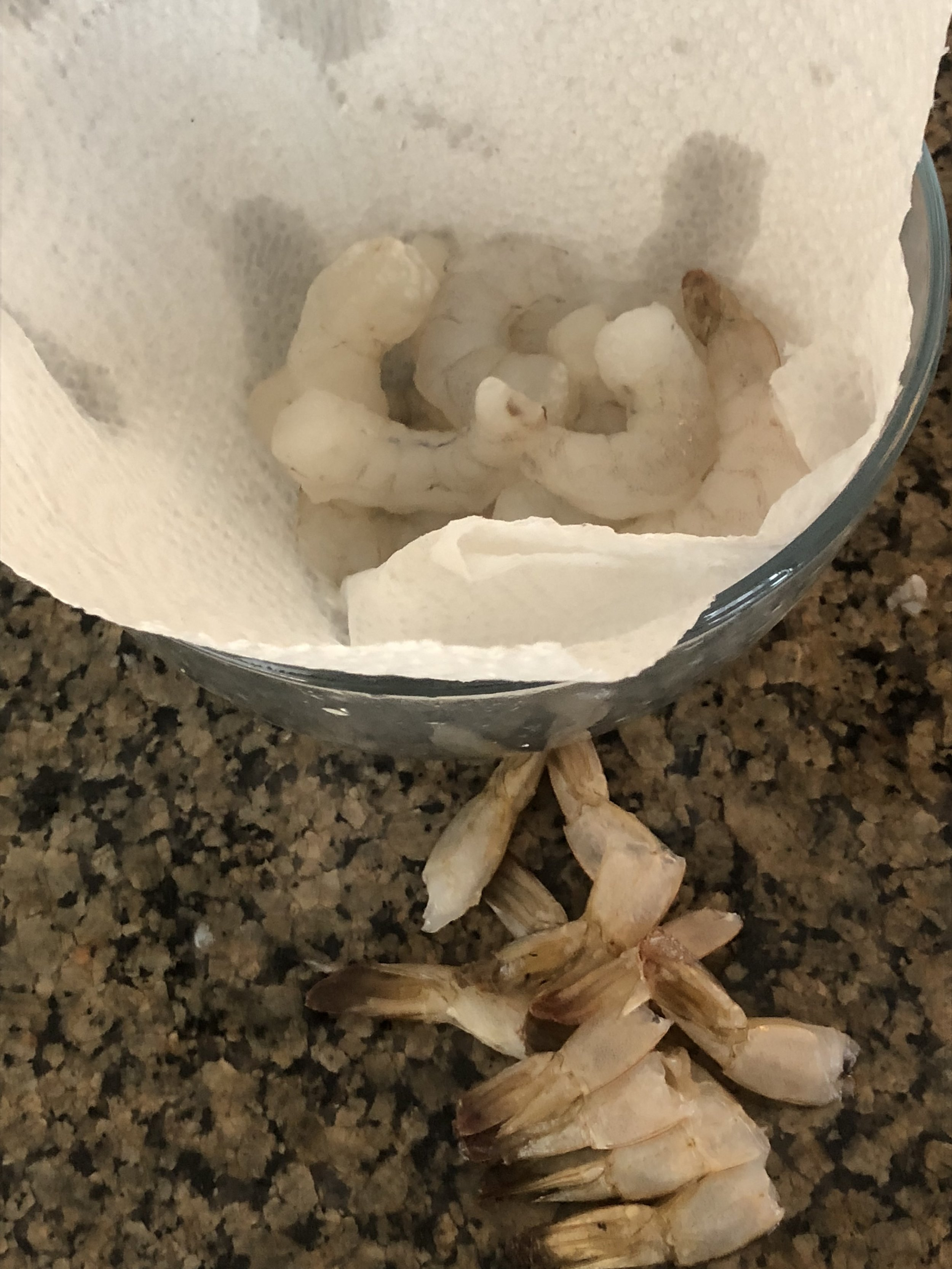 Defrost (if necessary), clean and detail/devein the shrimp. Rinse under cold water. Draping a paper towel over the bowl to catch the excess water, helps keep the shrimp crisp.