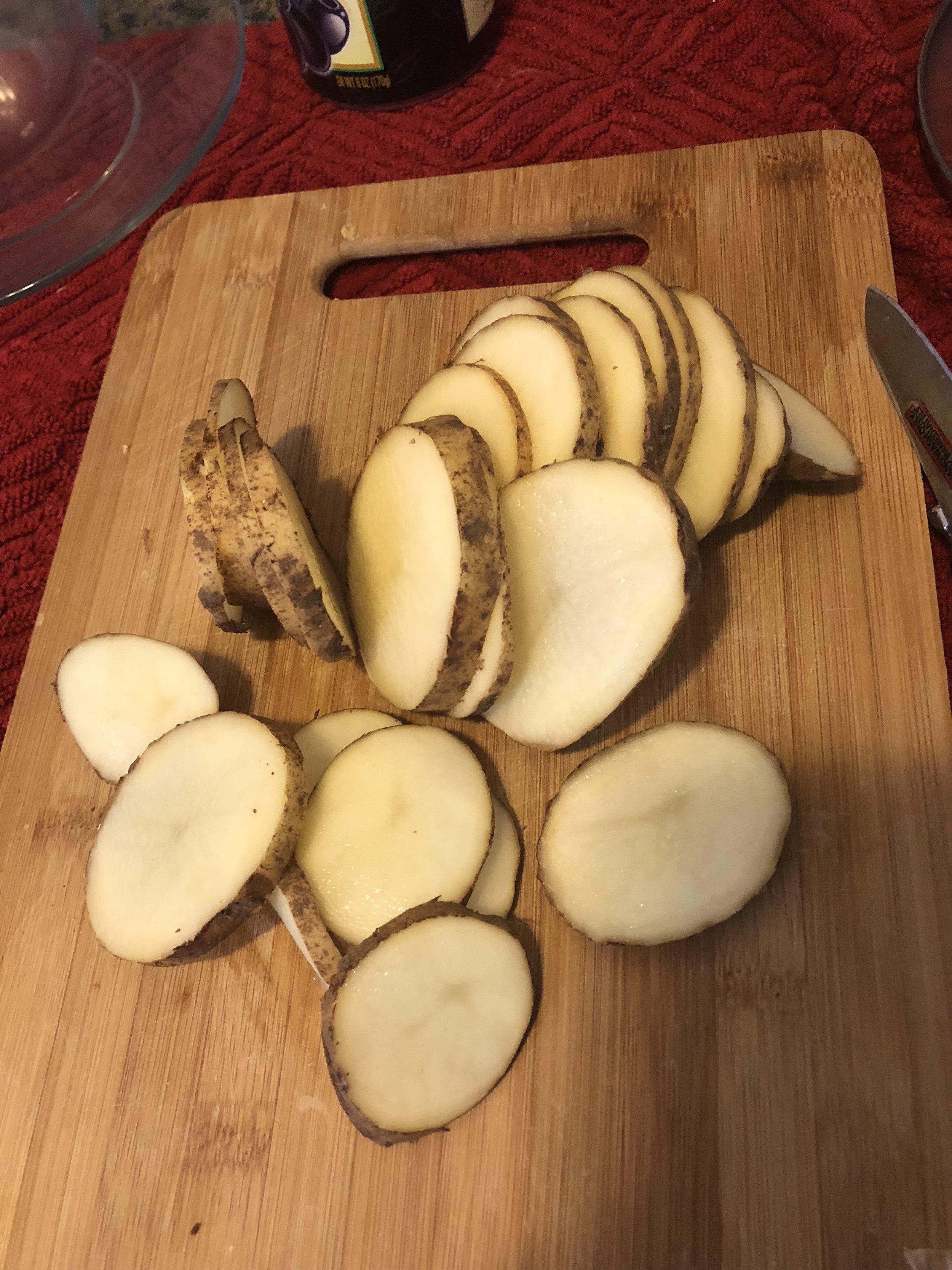 Slice the potatoes into thin coils horizontally