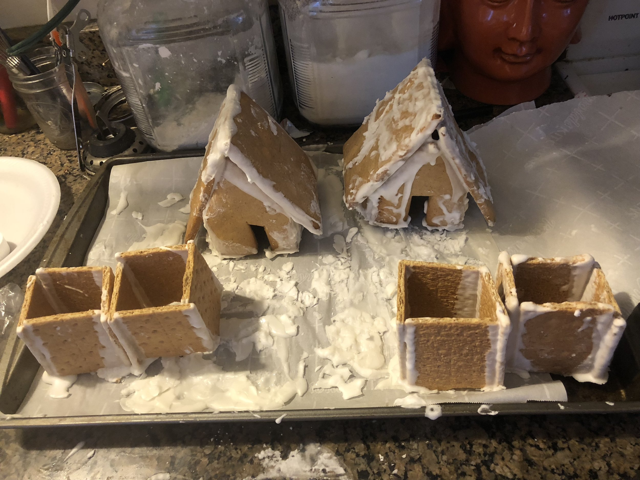 Royal Icing  5-8 egg whites  2 cups of powdered sugar  tsp of cream of tartar    Plan of Attack  Whip the egg whites and cream of tartar until sm peaks form  Gradually add in the powdered sugar; Store covered in your refrigerator.    * I used another gingerbread recipe than I have used in the past and I think you have to know what your house pattern looks like before deciding on a recipe. I should have use my rolling pi to make the gingerbread pieces thinner to make it easier to assemble!
