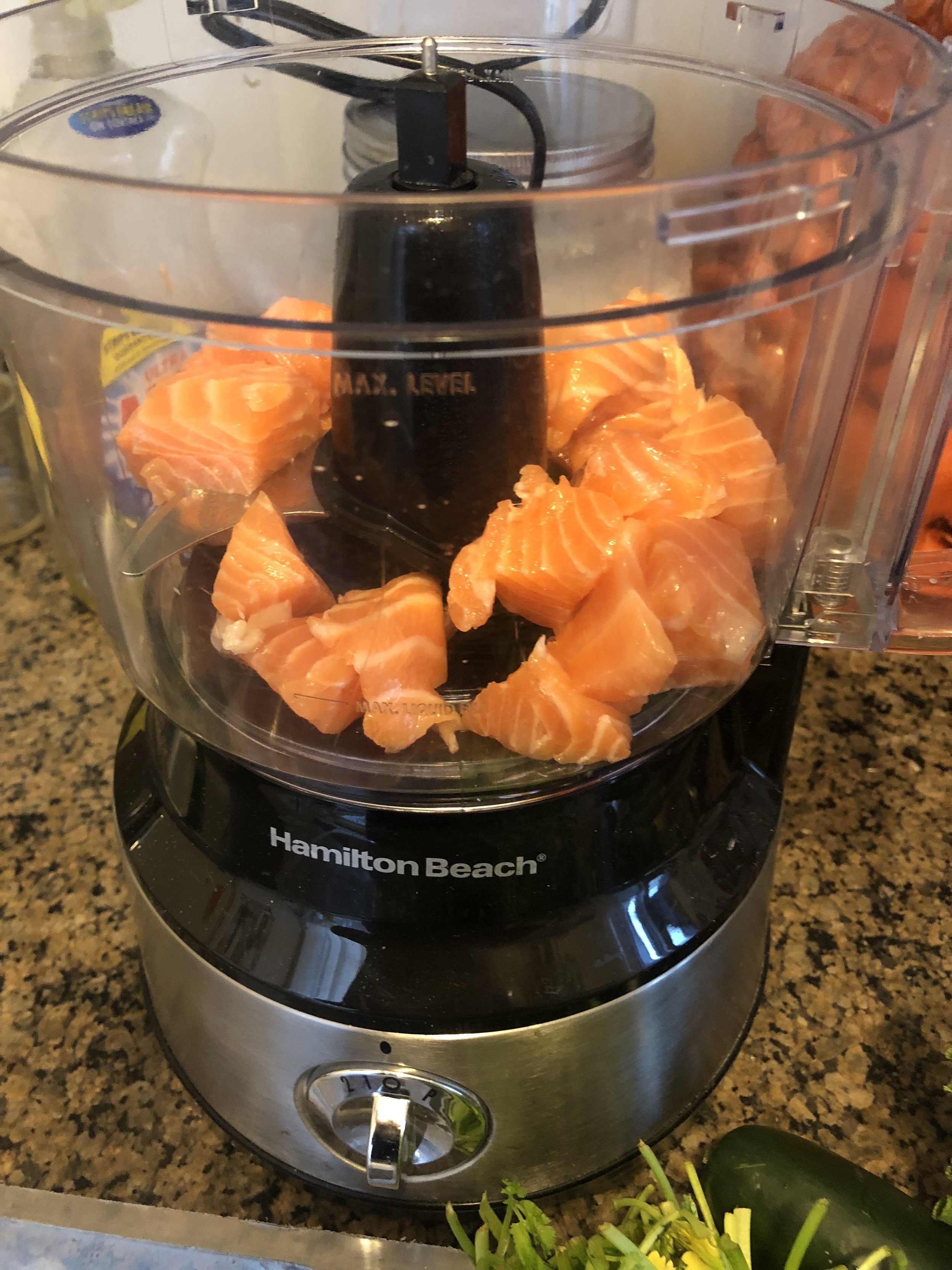 Cut the salmon into 2 inches cubes and place in your food processor. Process the salmon until it resembles a paste, but before it resembles a puree.