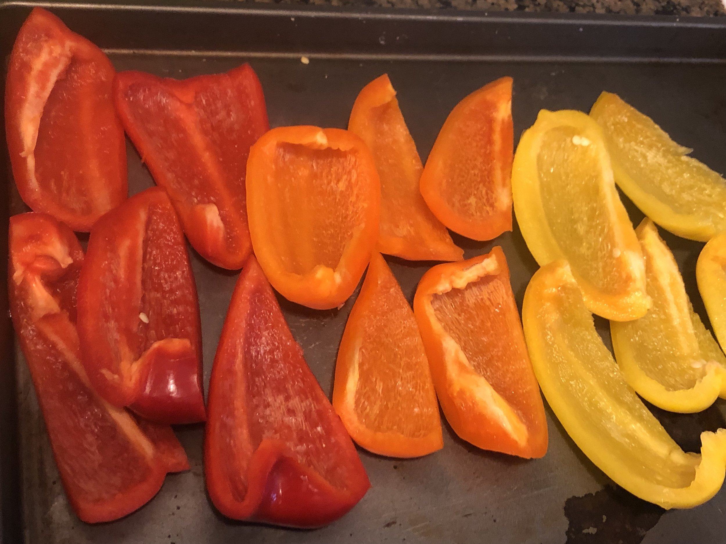 Cut bell peppers in half lengthwise and remove stems, ribs, and seeds; discard. Place bell peppers on a rimmed baking sheet and drizzle with 3 Tbsp. oil; season with salt and black pepper. Toss to coat, then turn cut side down and broil bell peppers on top rack, turning baking sheet front to back halfway through, until skins are blackened all over, 15–20 minutes.