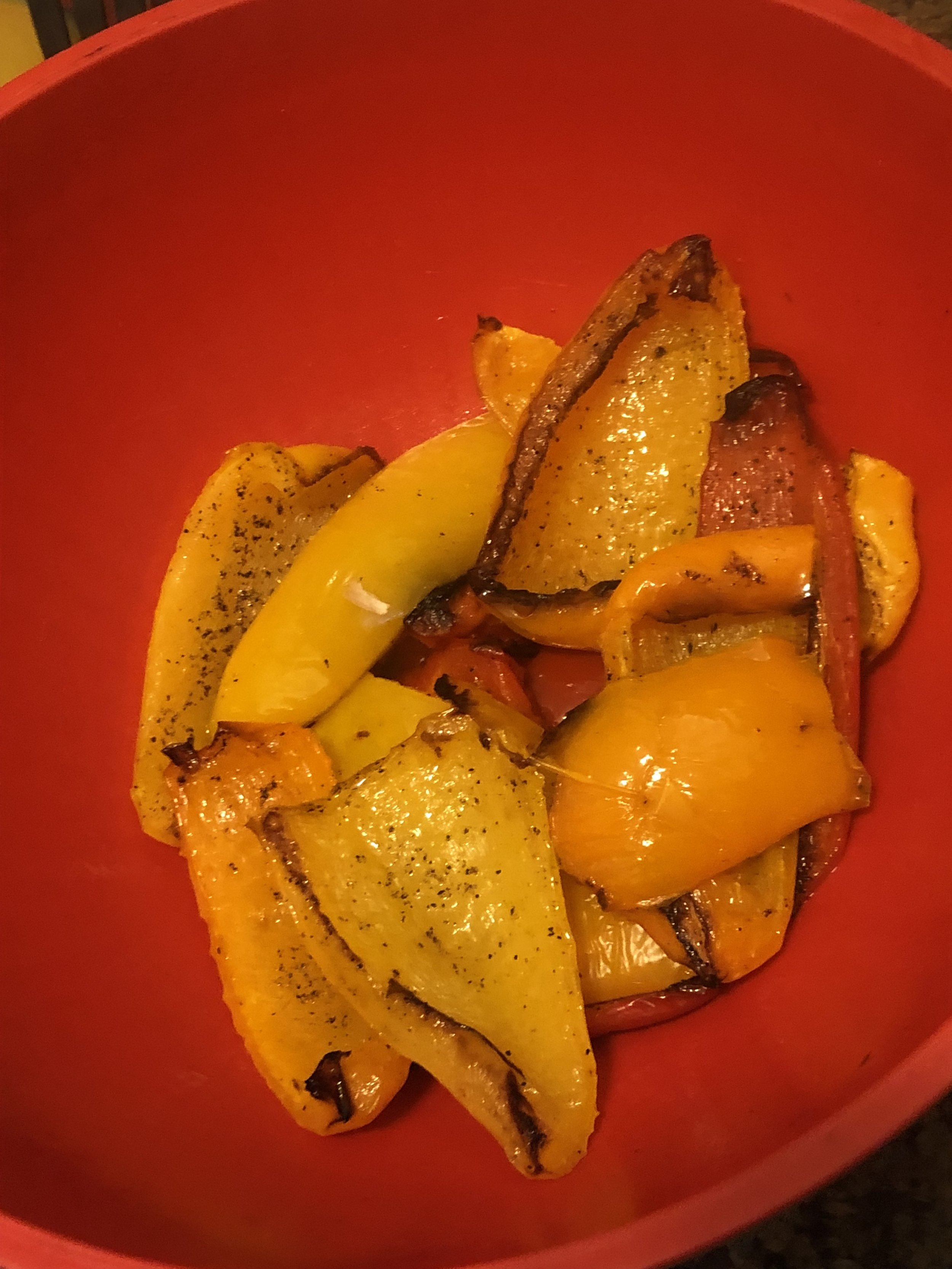 Uncover bell peppers and peel away charred skin from flesh (don't worry about getting every last bit); discard.