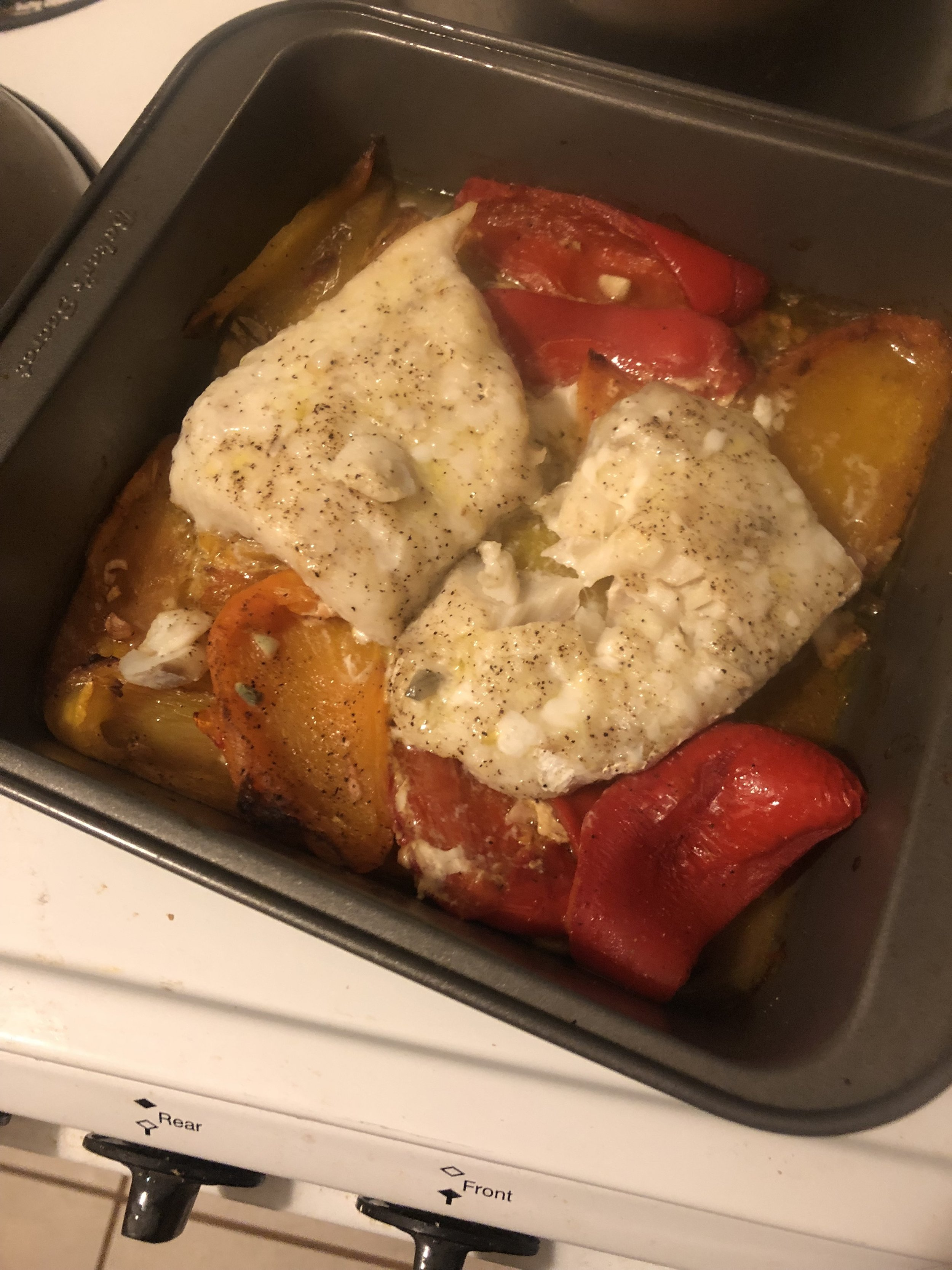 Nestle cod into bell pepper mixture, drizzle with 2 Tbsp. oil, and season with salt and black pepper. Roast on center rack until flesh is opaque throughout and flakes easily when pressed, 25–30 minutes. Let rest 10 minutes.