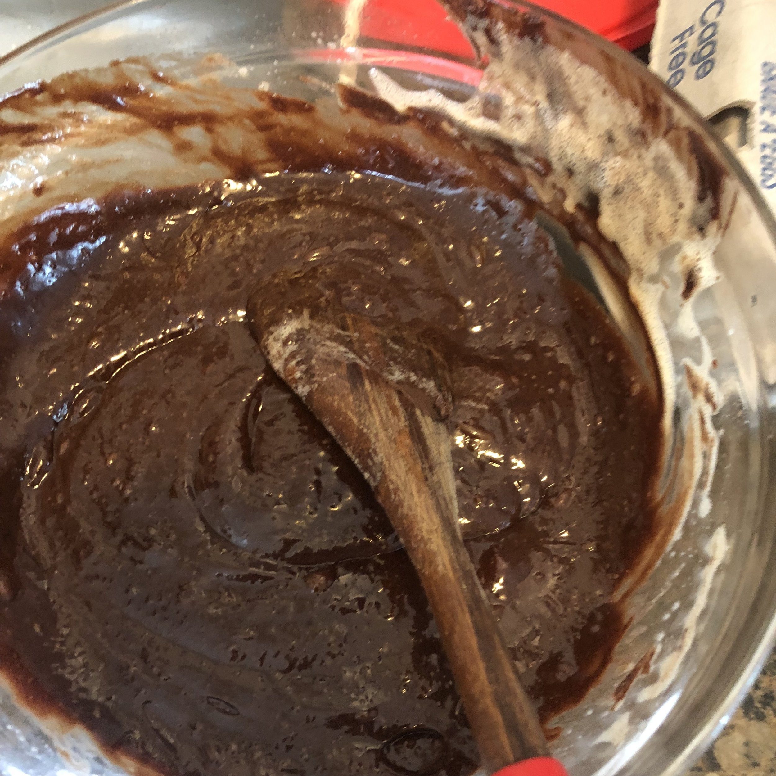 The mixture should resemble a very smooth cake batter when completely integrated. Pour the batter into a foil lined springform pan and place the pan on a baking sheet. Place in the oven for 36 -41 minutes.