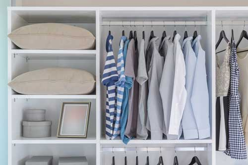 depositphotos_80063670-stock-photo-clothes-hanging-in-white-wardrobe.jpg