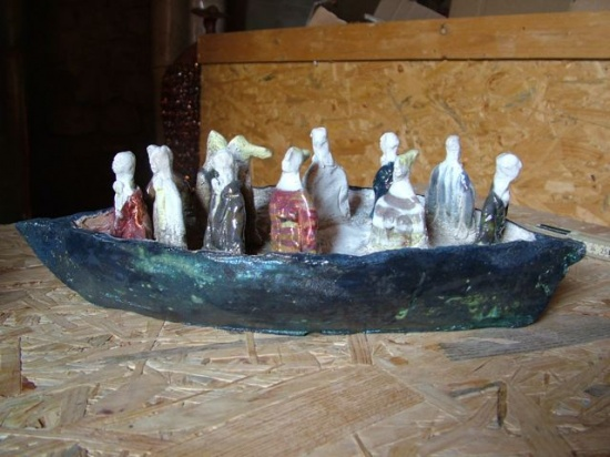 """Blue Boat with travelers,  ceramic, 15"""" x 5""""d x 5"""" h, a smaller available also"""