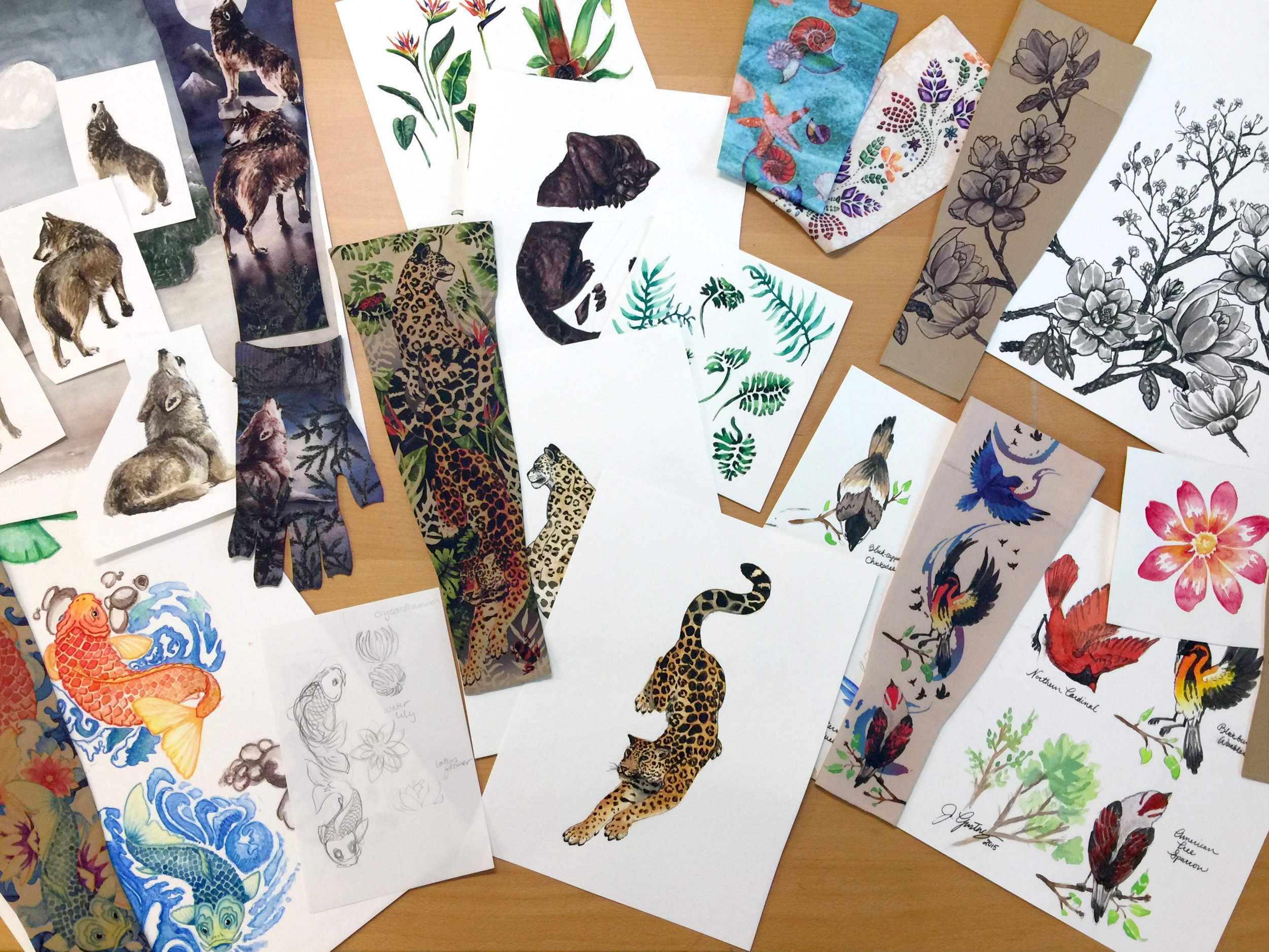 A variety of patterns that include paintings in their design.