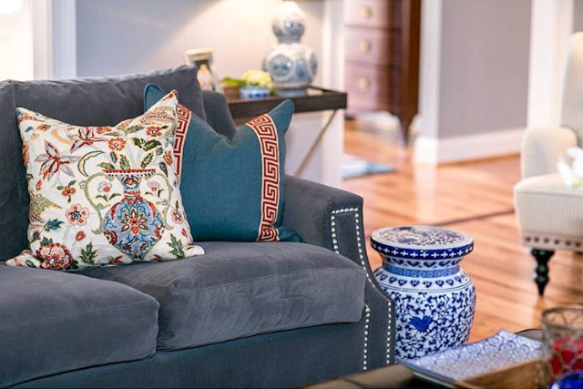 EllebrightDesigns.familyroom.graysectional.blueandwhite.greekkeytrimpillow