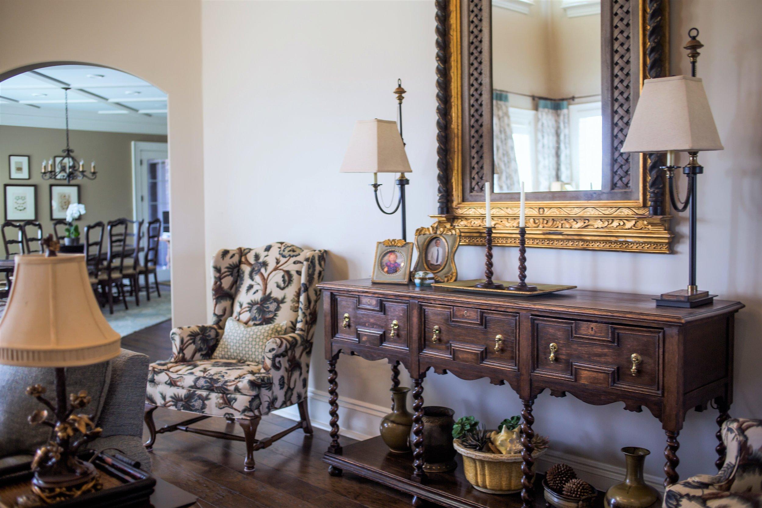 ellebrightdesigns.familyroom.antiqueconsole.hugeantiquemirror.wingback