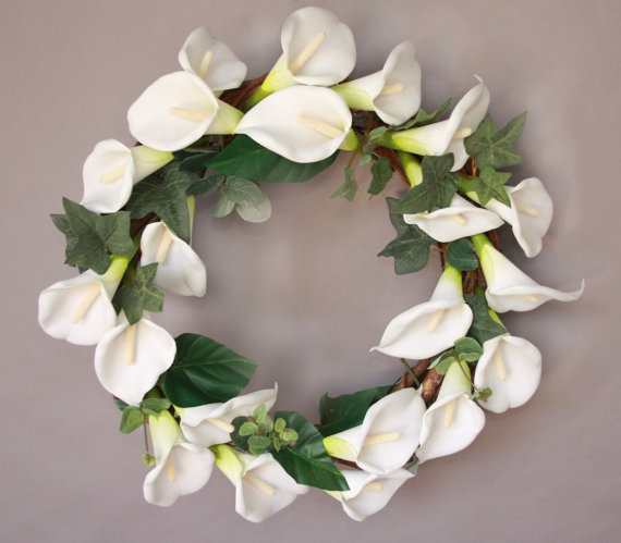 It doesn't have to be black. Here's a white lily mourning wreath from the Widowstrength shop on Etsy.com