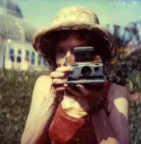 Denise taking a polaroid photo at Como Park