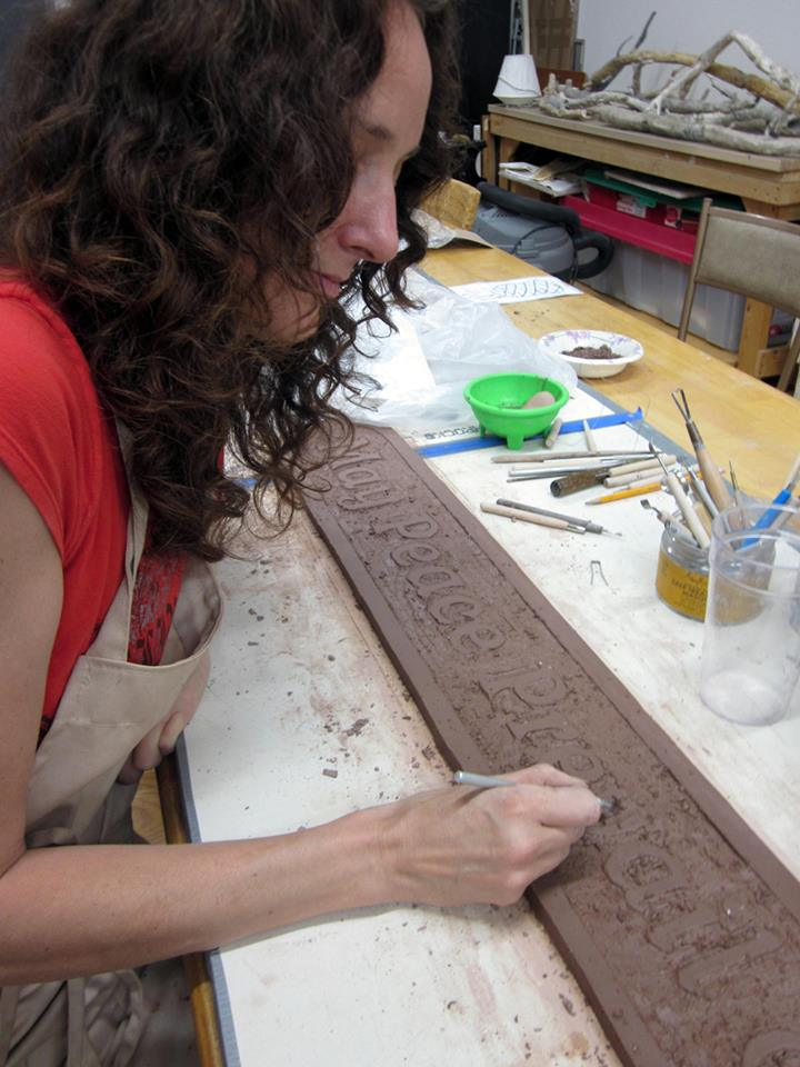Carving the clay tiles