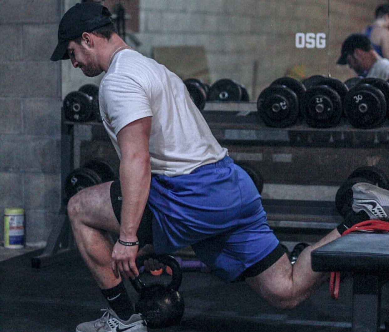 Coach Nign performing a split squat