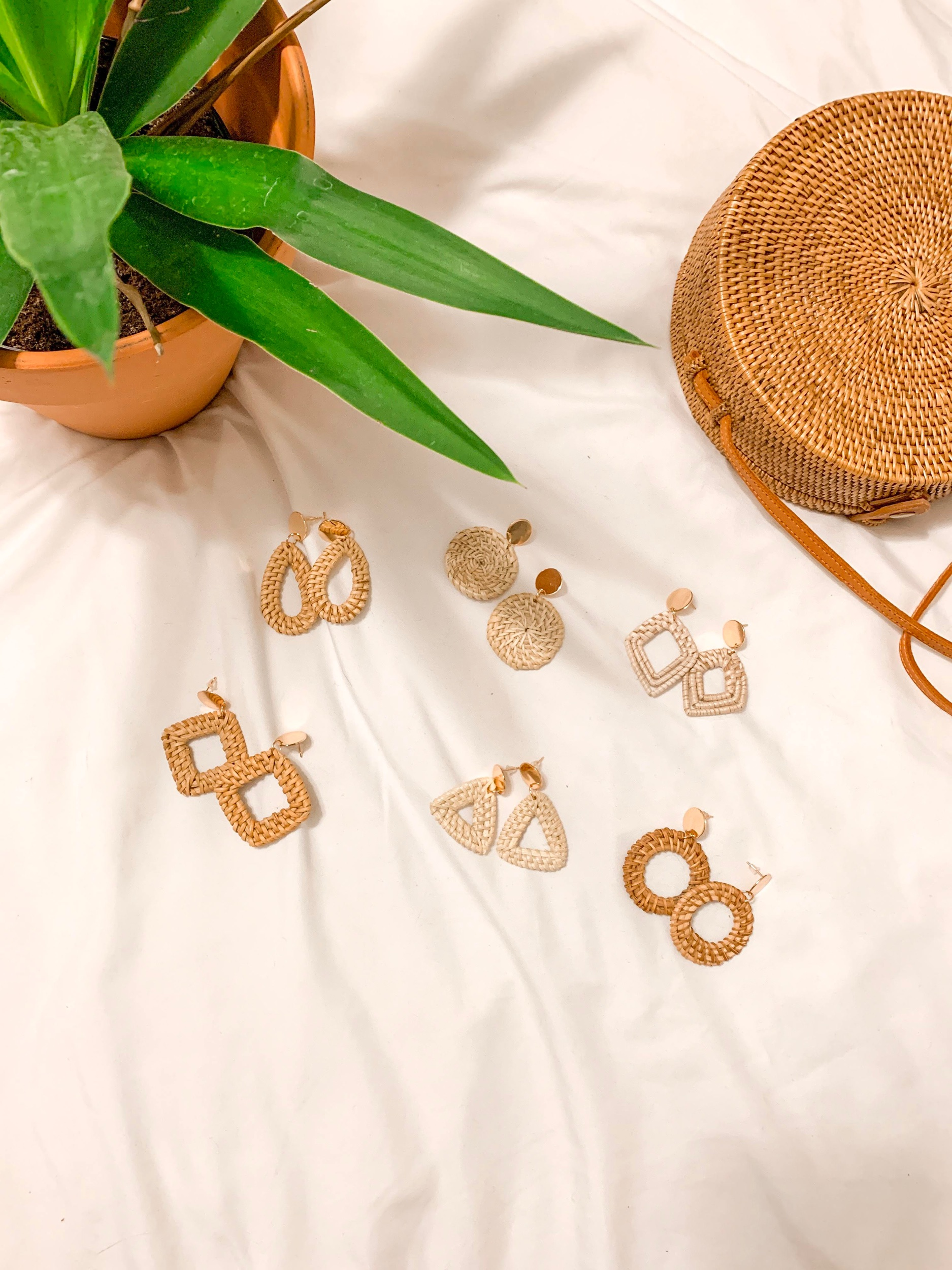 Six sets  of rattan seagrass earrings for $13! They have gold posts and all come in different colors and styles. The perfect summer accessory!