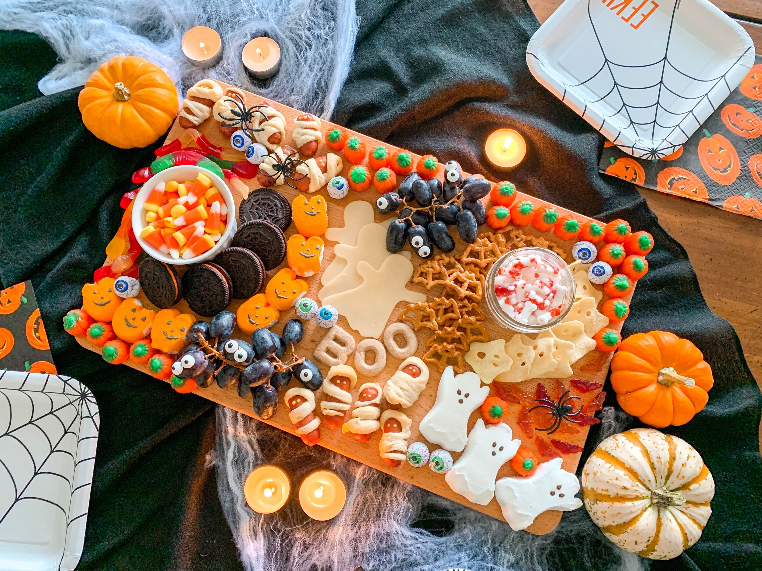 Mix candy, snacks and fruit for a fun and festive Halloween themed charcuterie board.